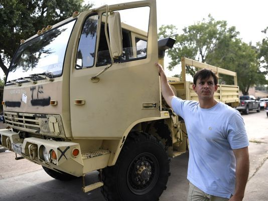 Nick Sissa used his military vehicle during Hurricane Harvey to rescue people from their flooded homes in the Meyerland neighborhood of Houston.(Photo: Danielle Parhizkaran, Northjersey.com via USA TODAY NETWORK)