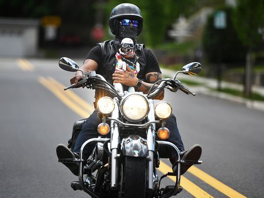 John Burgos rides his motorcycle with his dog Bella strapped to his chest. (Photo: Michael Karas/Northjersey.com)