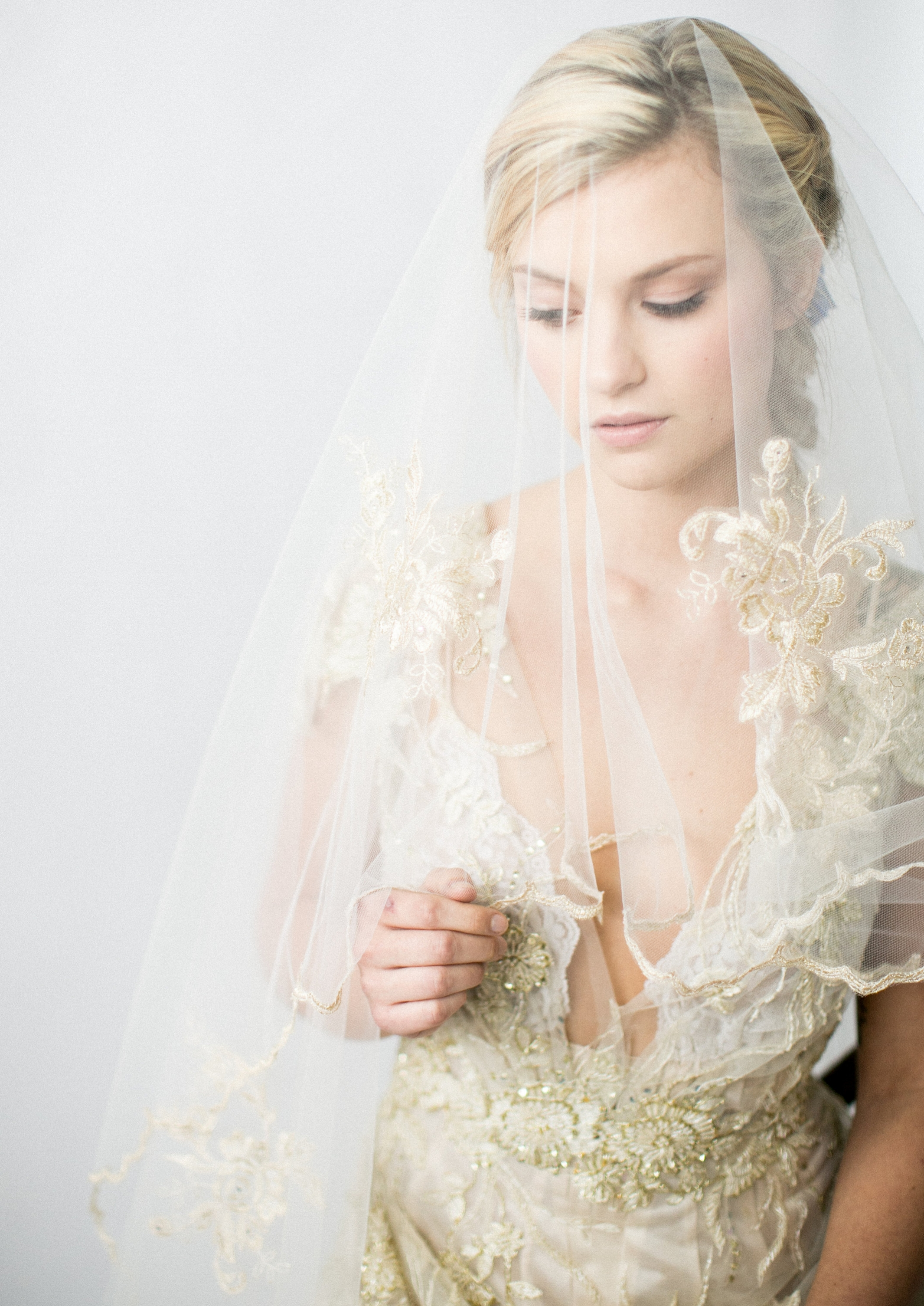 Custom Veil - Annie Ekstrom Bridal specializes in creating custom bridal styles. Annie Ekstrom Bridal can create a one-of-a-kind piece that will become a bridal heirloom for generations to come.Veil elements that can be customized:- Length- Material- Lace applique- Style- CombEach item is made to order exactly to the bride's specifications.Annie specializes in:- Designing new styles- Designing new styles using laces or materials from designer gowns
