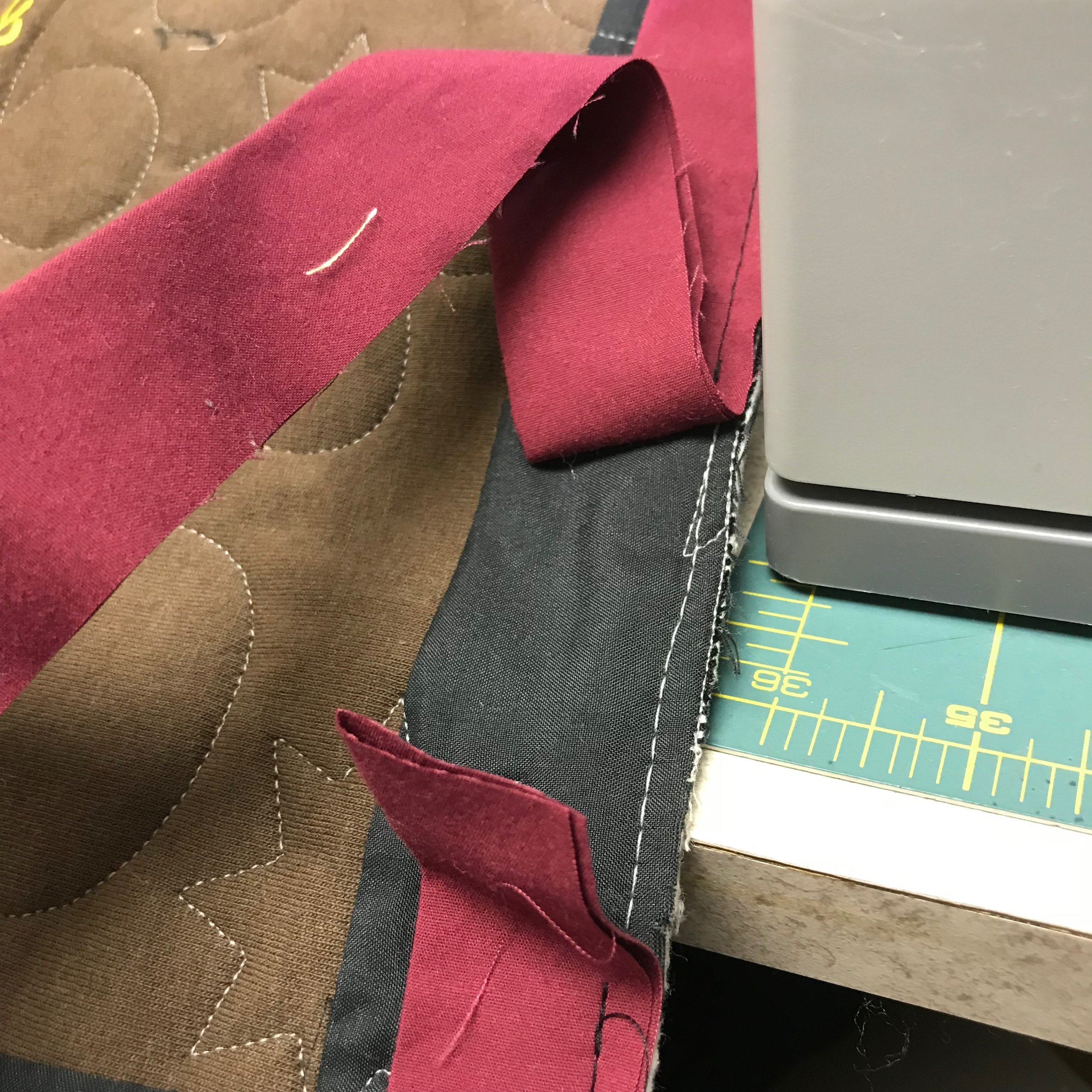 """When you get to about 3"""" from the first tail you stitched, stop. Trim the binding tail to leave about a 6"""" tail to work with."""