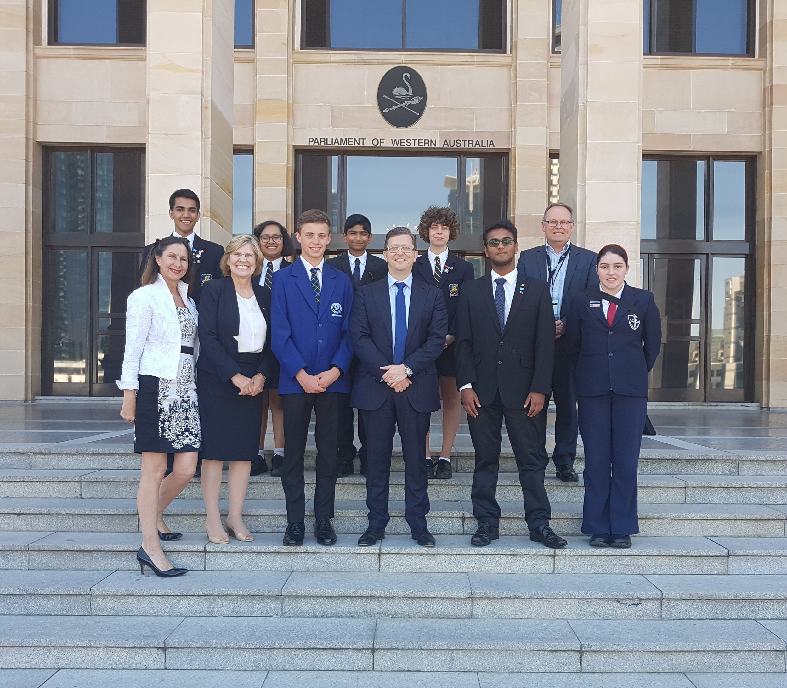 Hon Tjorn Sibma MLC on the steps of the Western Australian Parliament with Professor Lyn Beazley AO FTSE and Ms Susie Norvilas from the Royal Commonwealth Society,winners of the Royal Commonwealth Society Speech and Leadership Contest 2017 and Hon David Templeman, MLA
