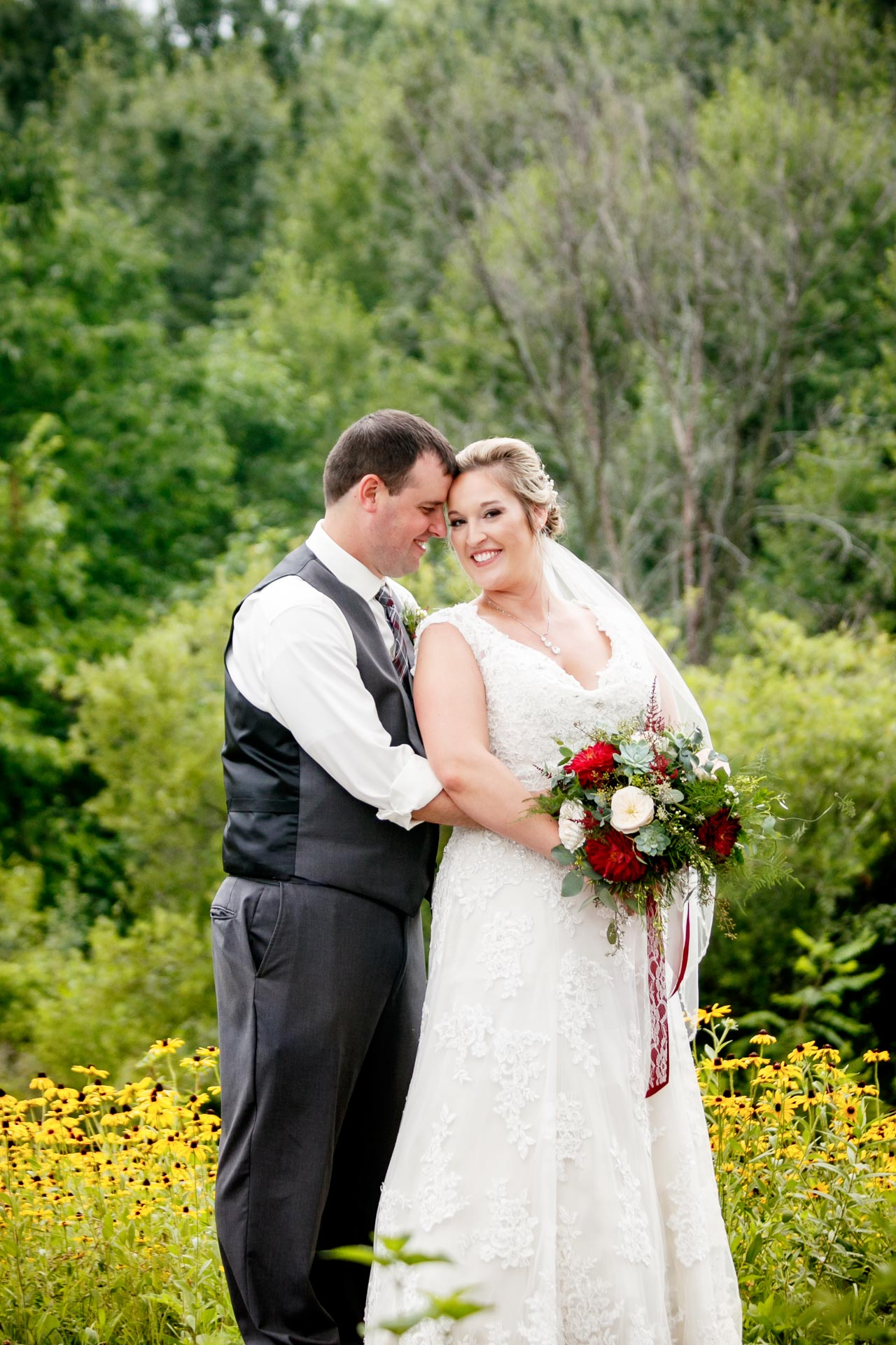 Rain wouldn't soak Sarah and Cory's vision for their wedding day.  It went off without a hitch!