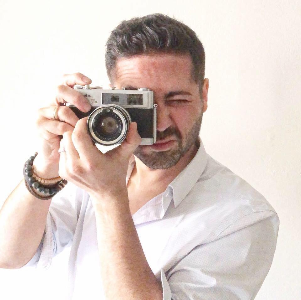 Adam Taking Photo