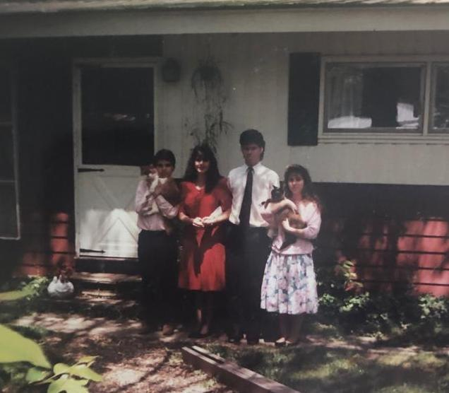 Casey with two of his four siblings and girlfriend and the cats MacArthur and Muffin in front of their home in rural Onondaga County, NY