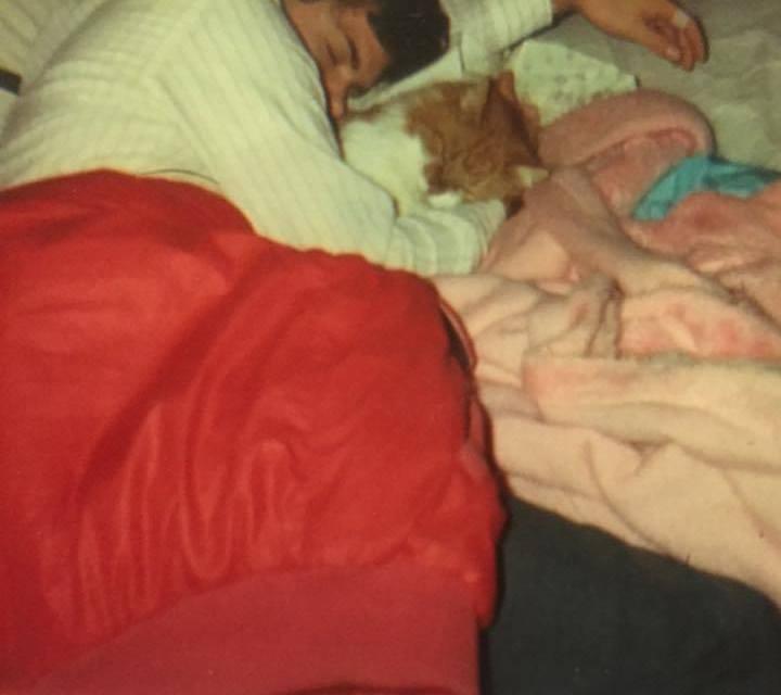 Teenage Casey cuddling with MacArthur