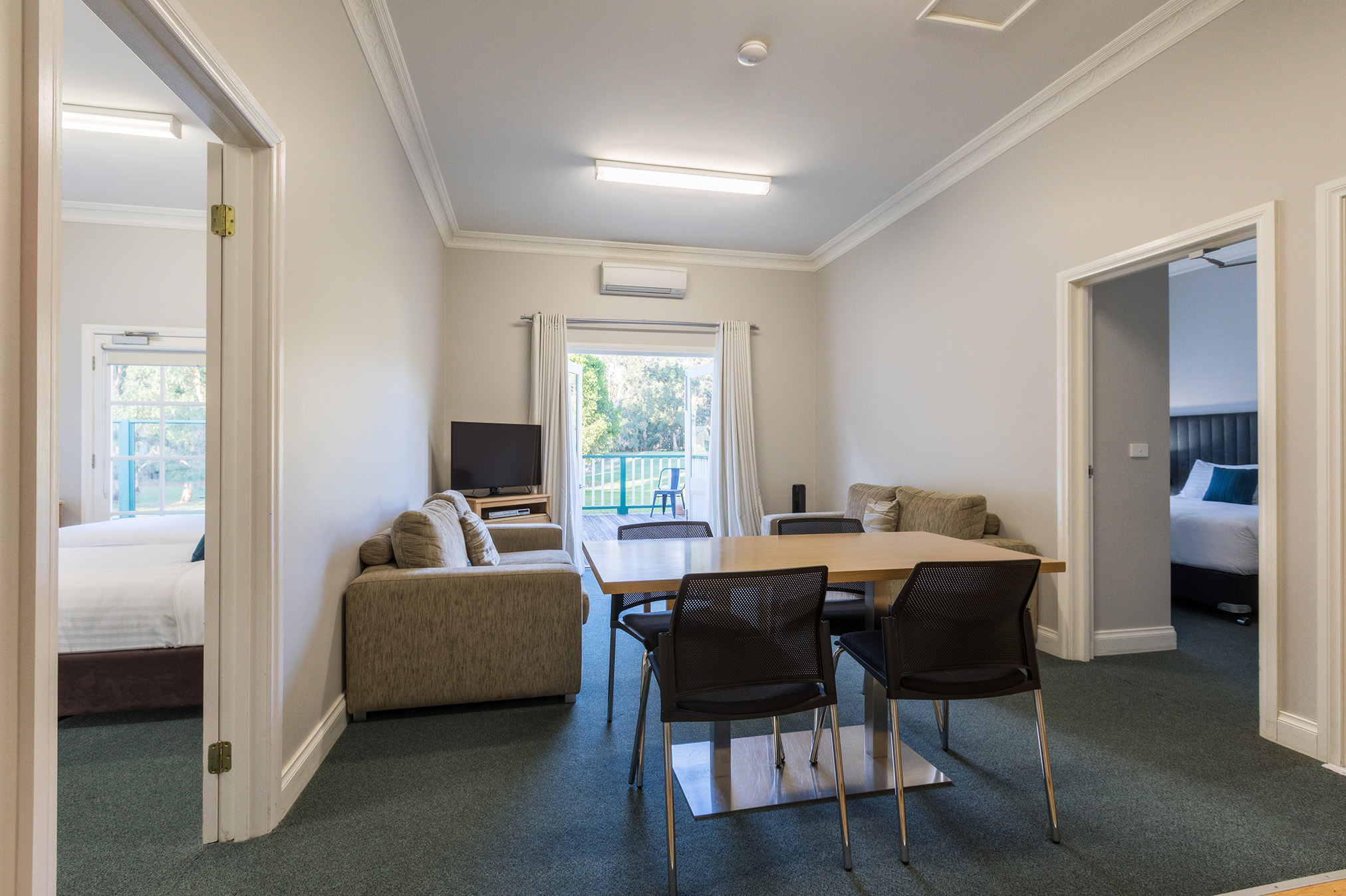 Two Bedroom Apartment - Our Two Bedroom Apartment allows you to share accommodation with your traveling party, with 2 beautifully appointed King bedrooms joined by a comfortable private lounge.You also have your own balcony overlooking the expansive lawns running down to the babbling Yarra.This delightful Apartment adjoins our Studio-Conference Room and is a favourite for groups sharing various learning and practical sessions together.
