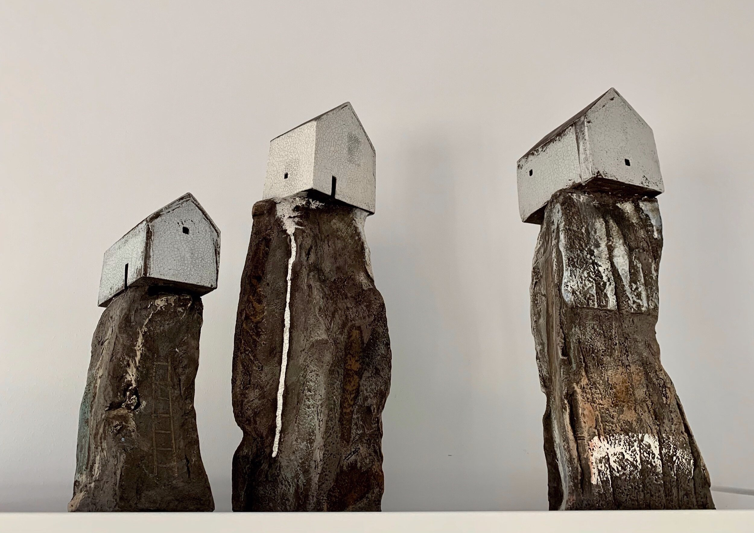 Three house on rock sculptures, 23 - 35cm height