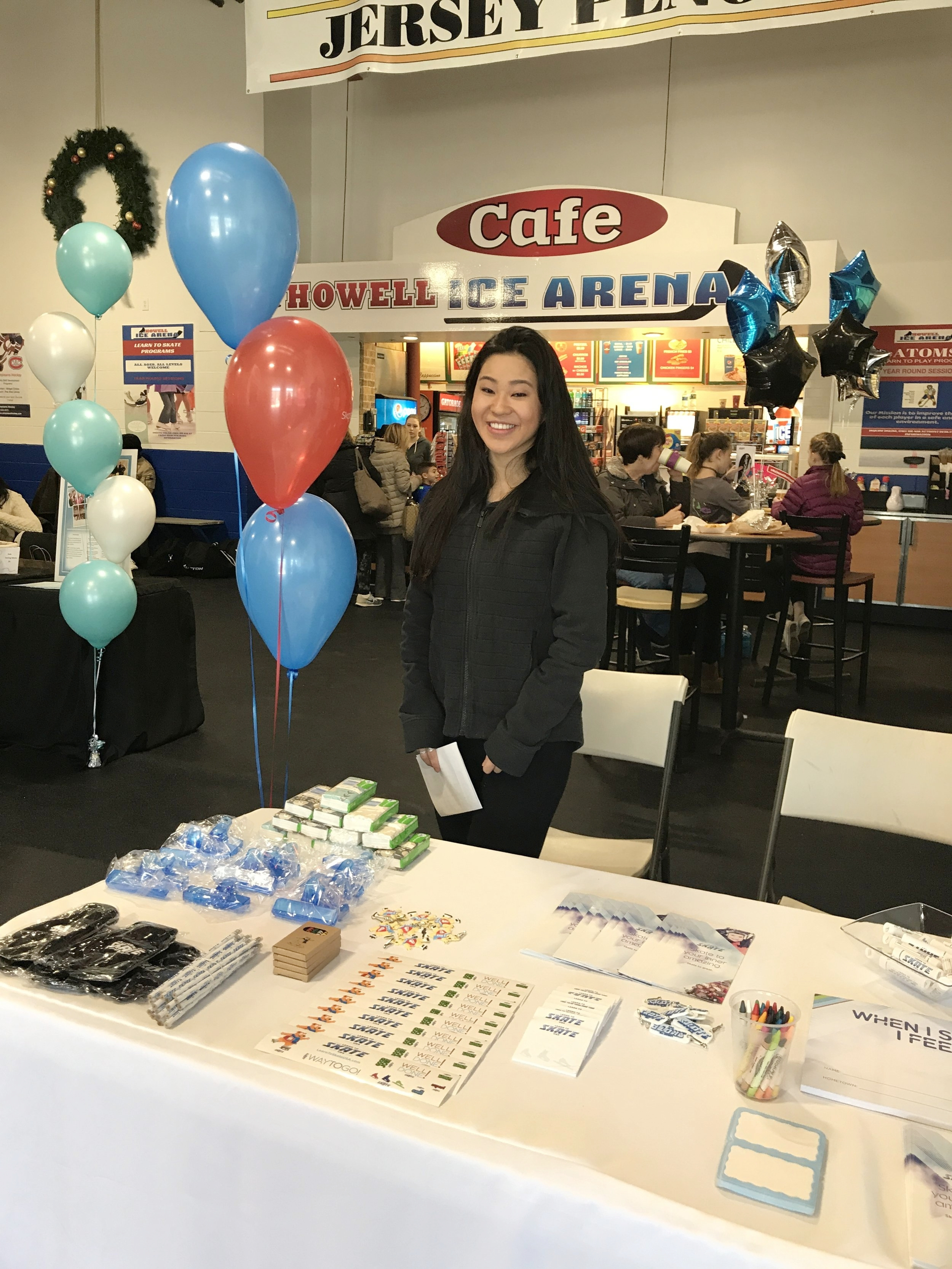Setting up registration table and putting together goodie bags filled with U.S. Figure Skating promotional items for all the skaters