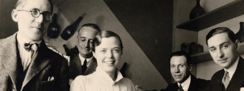 Le Corbusier, Charlotte Perriand, Djo Bourgeois, Jean Fouquet with Percy Sholefield in background in her apartment in Saint-Sulpice, Paris, 1928.