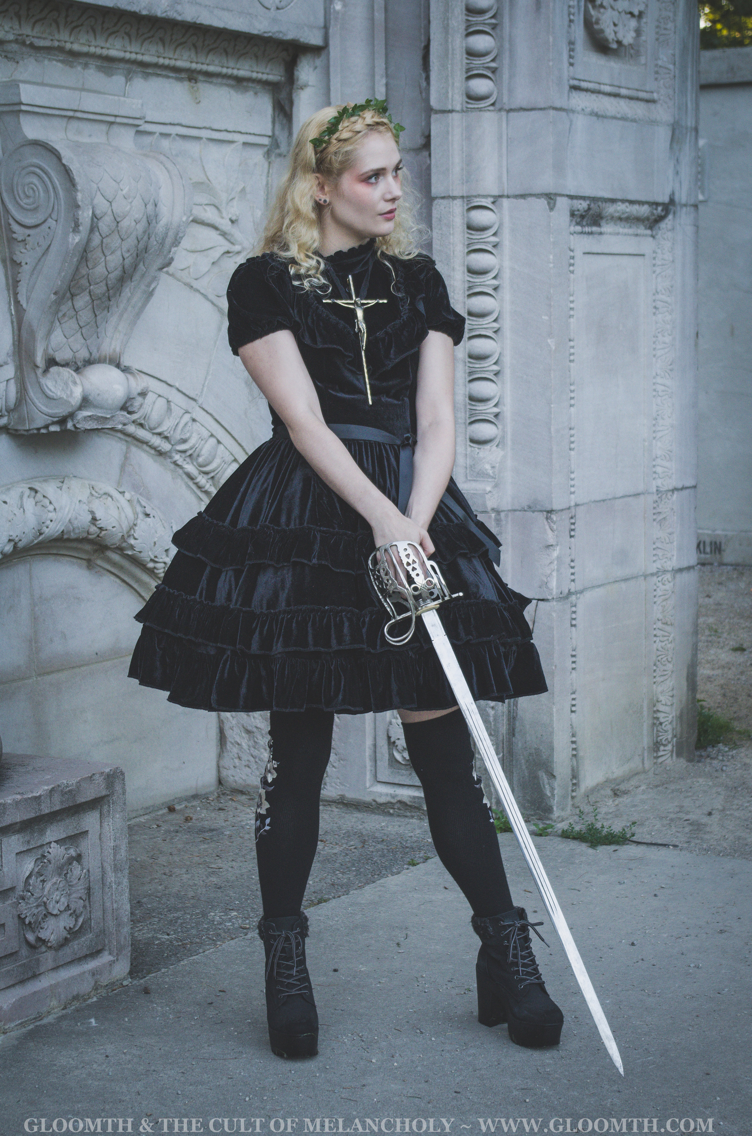 joan of arc with velvet dress and sword editorial