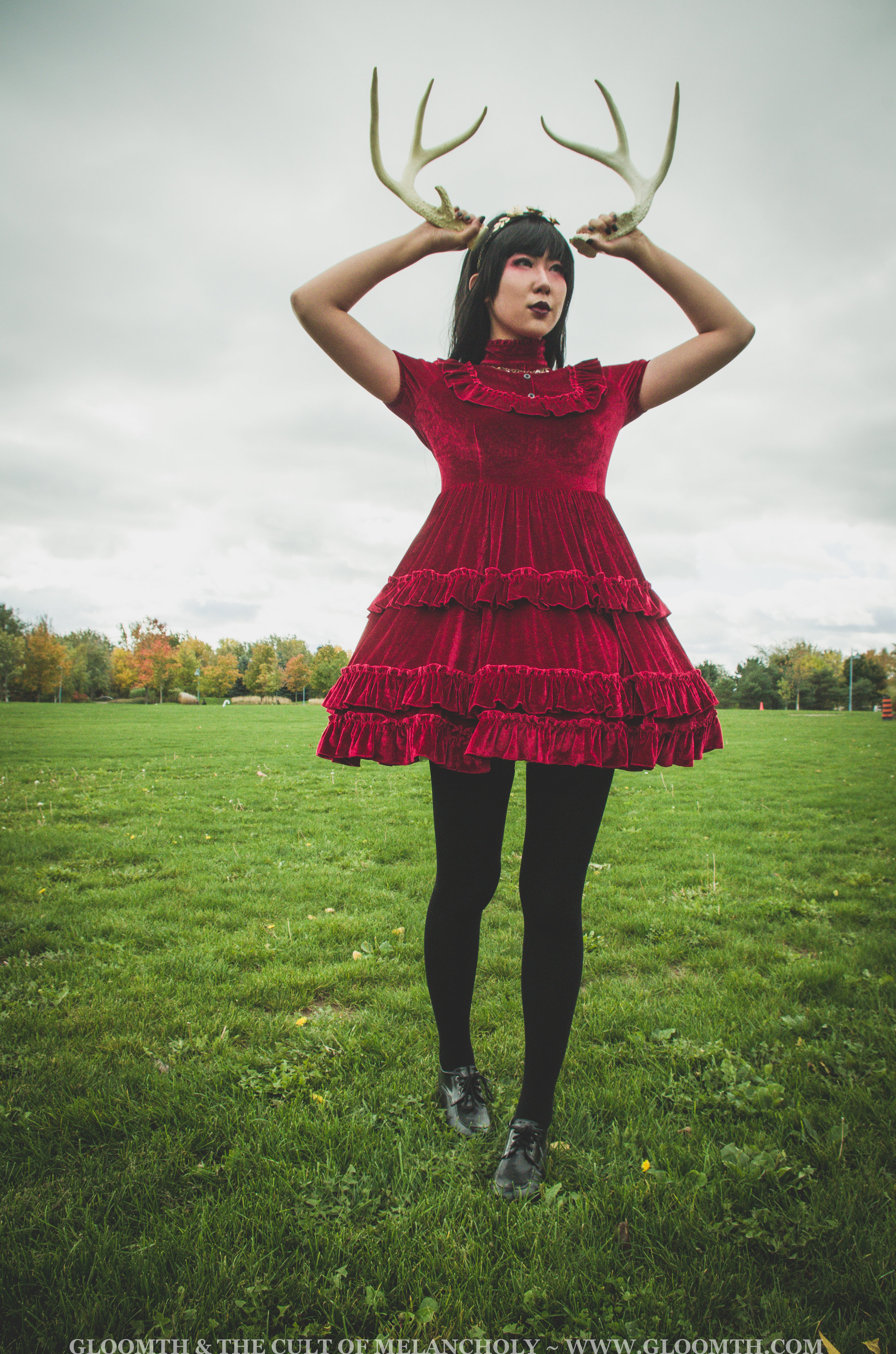 red velvet dress with antlers