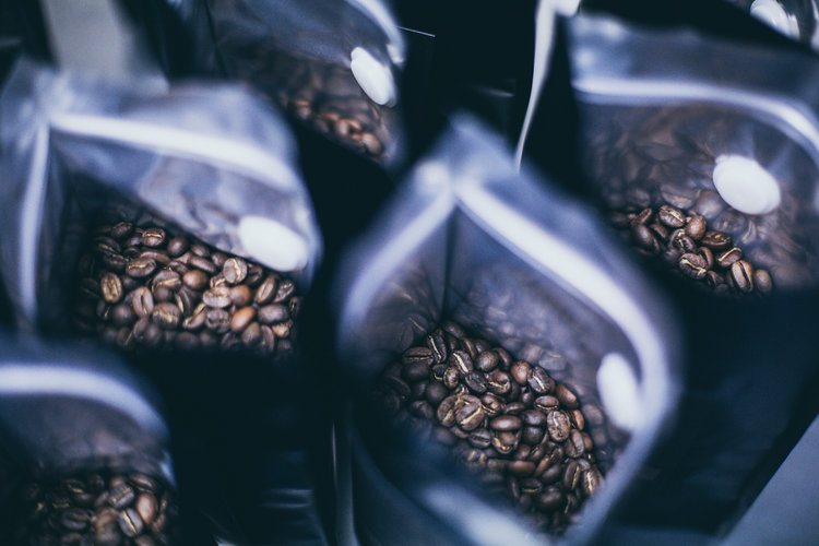 Coffee beans in Saint Espresso bags
