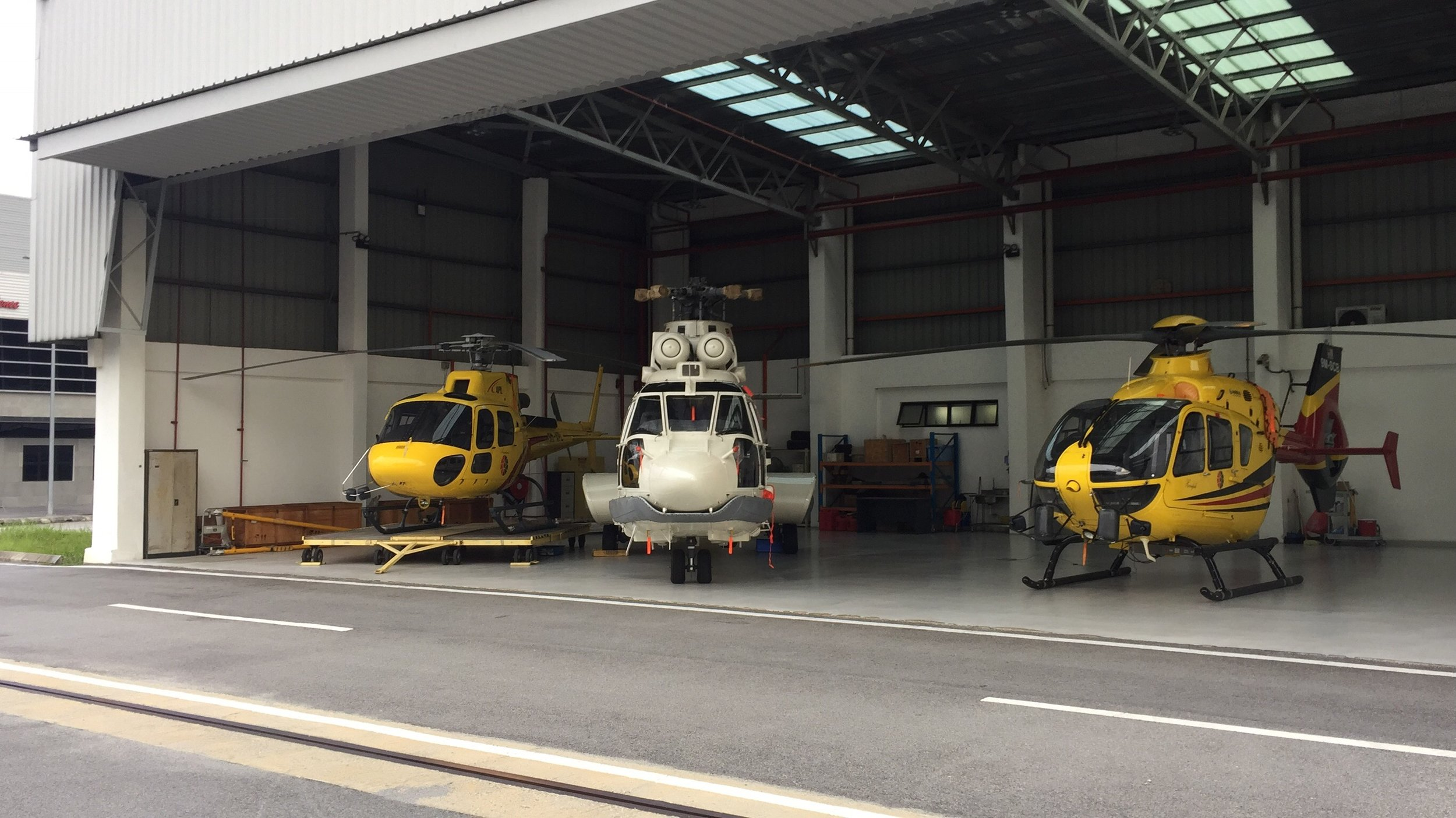 Three helicopter at the Hangar