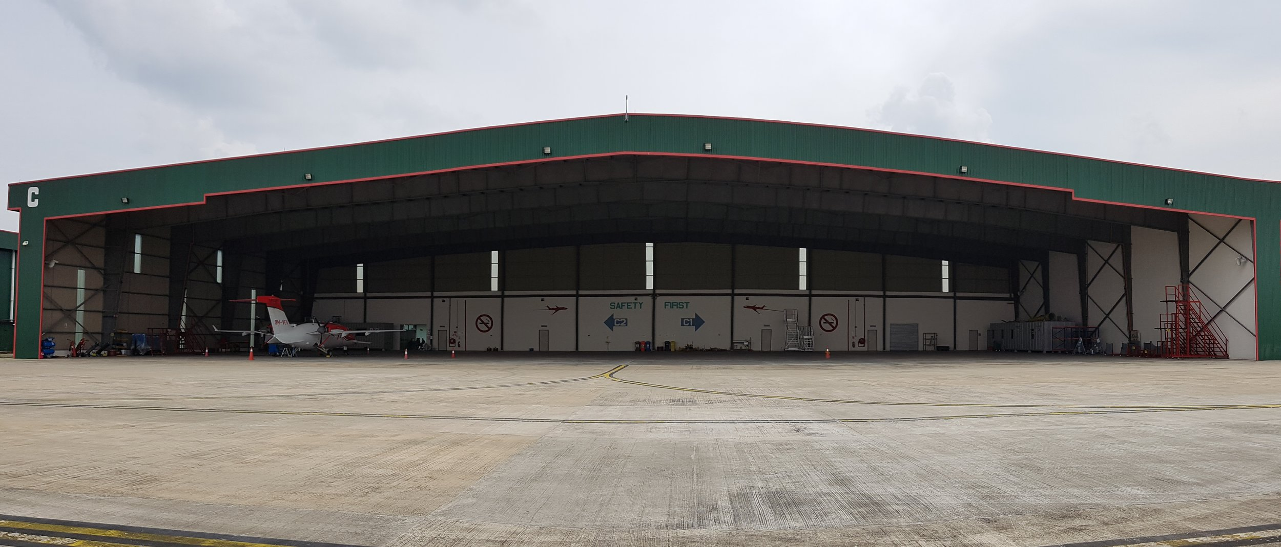 A Piaggio Avanti Evo docked at Hangar C, Skypark RAC, awaiting maintenance service.