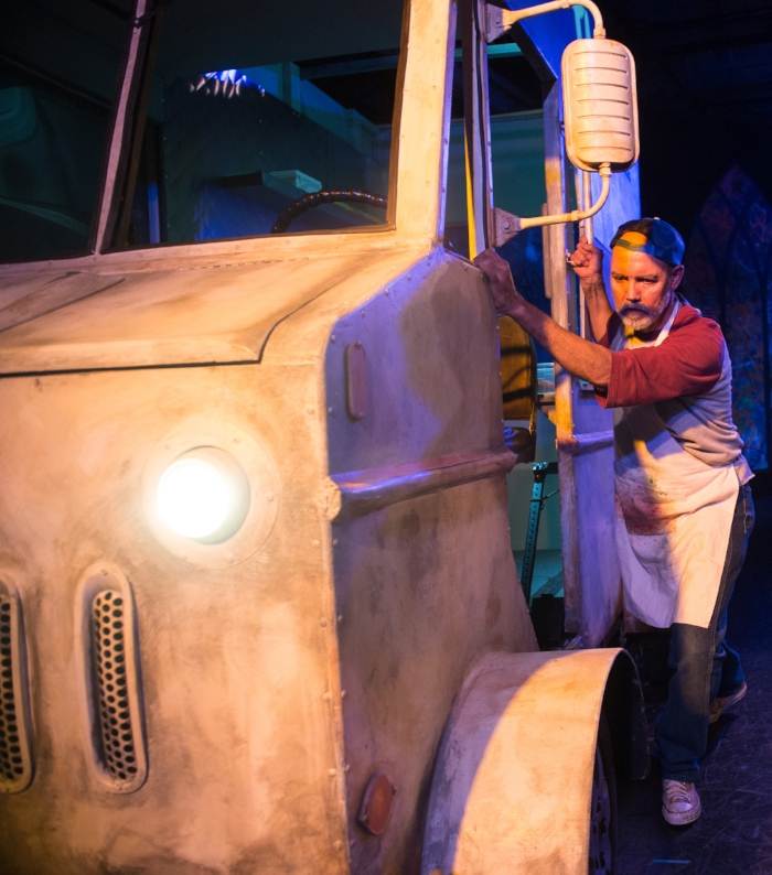 Jesús Castaños-Chima pushes his new taco truck onstage at ICE, commissioned and produced by 24th ST Theatre. Photo by Cooper Bates.