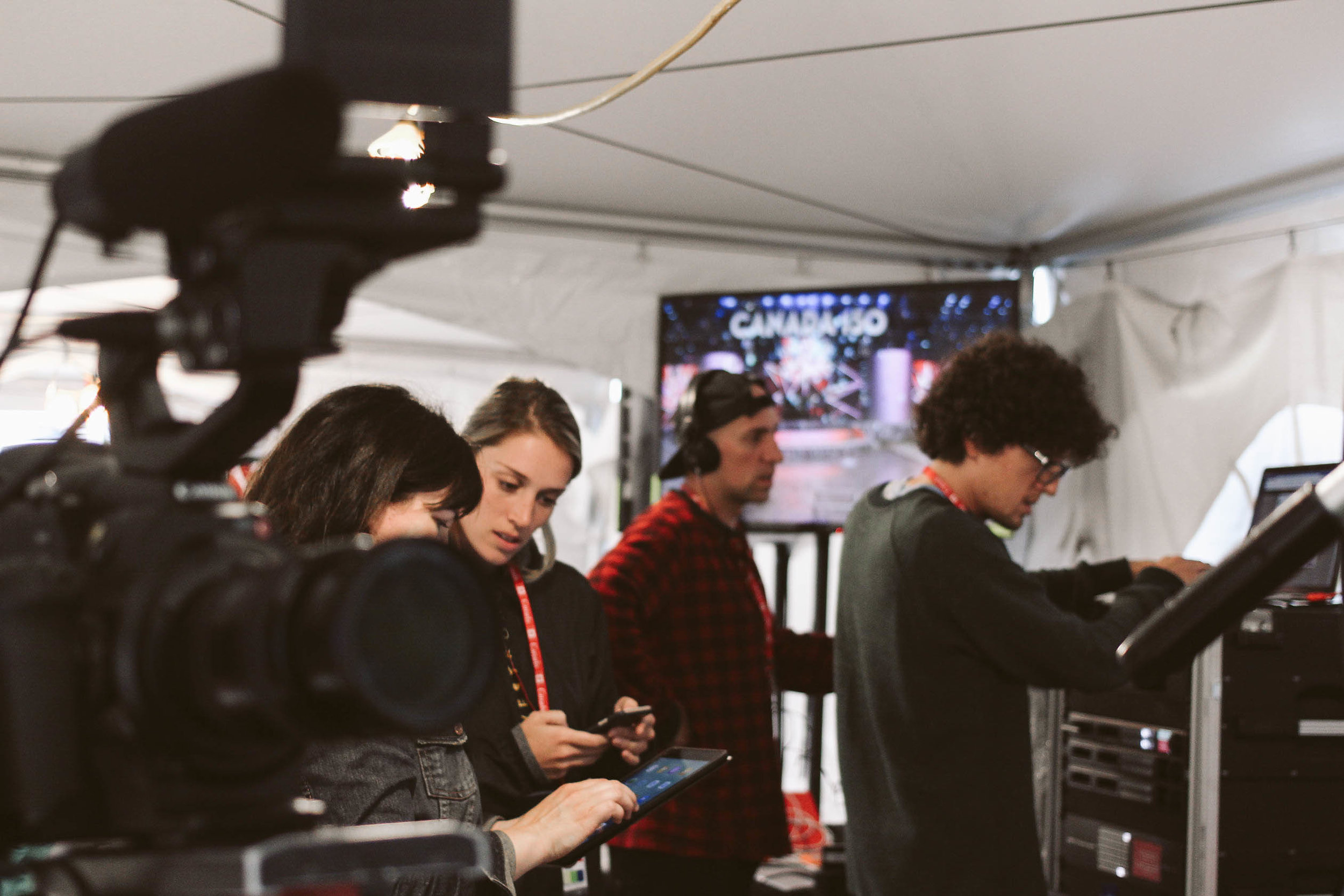 Behind-the-scenes photography of the live stream team at Canada 150