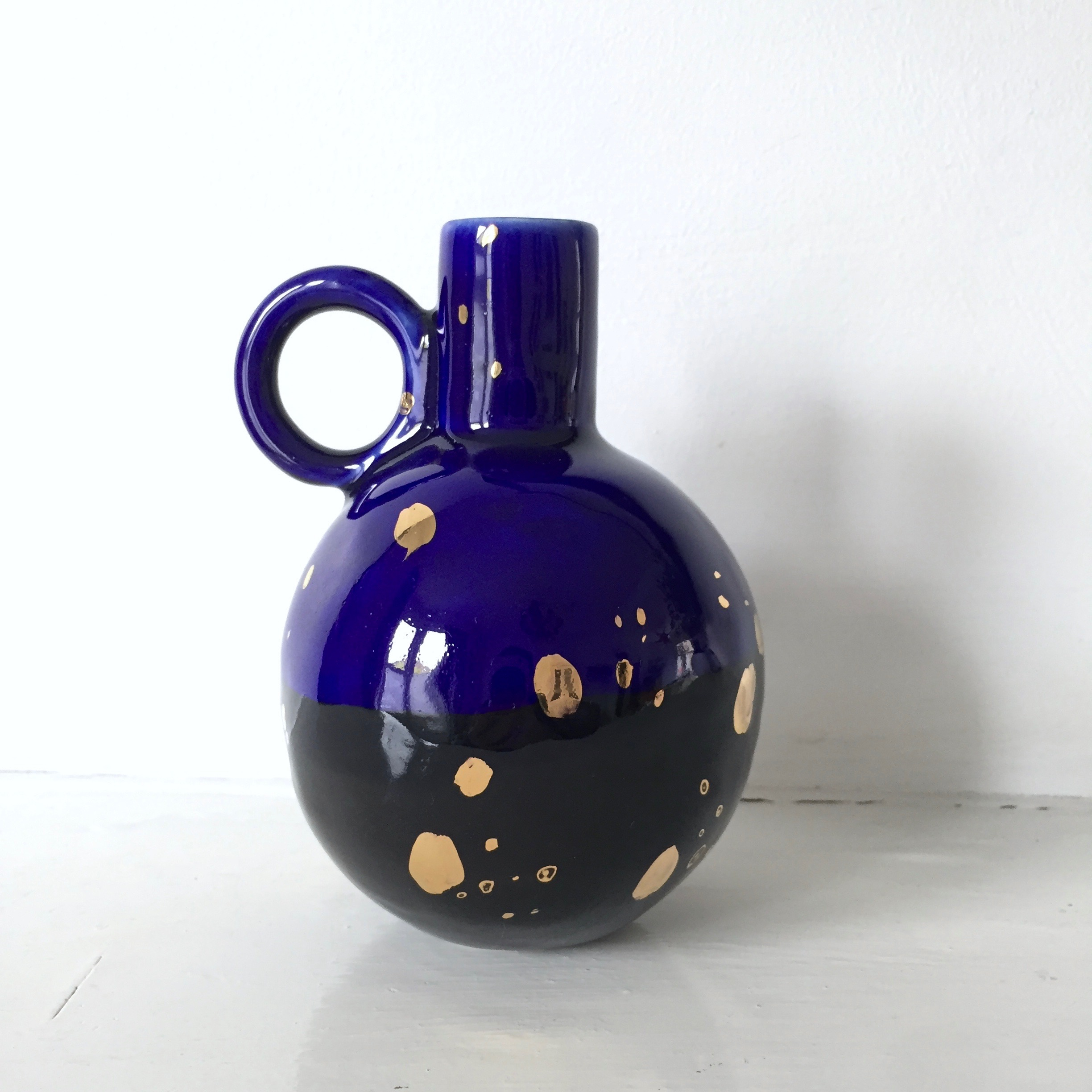 Galaxy Vase  Porcelain with black and navy glaze and gold lustre. 12 to 15 cm tall.