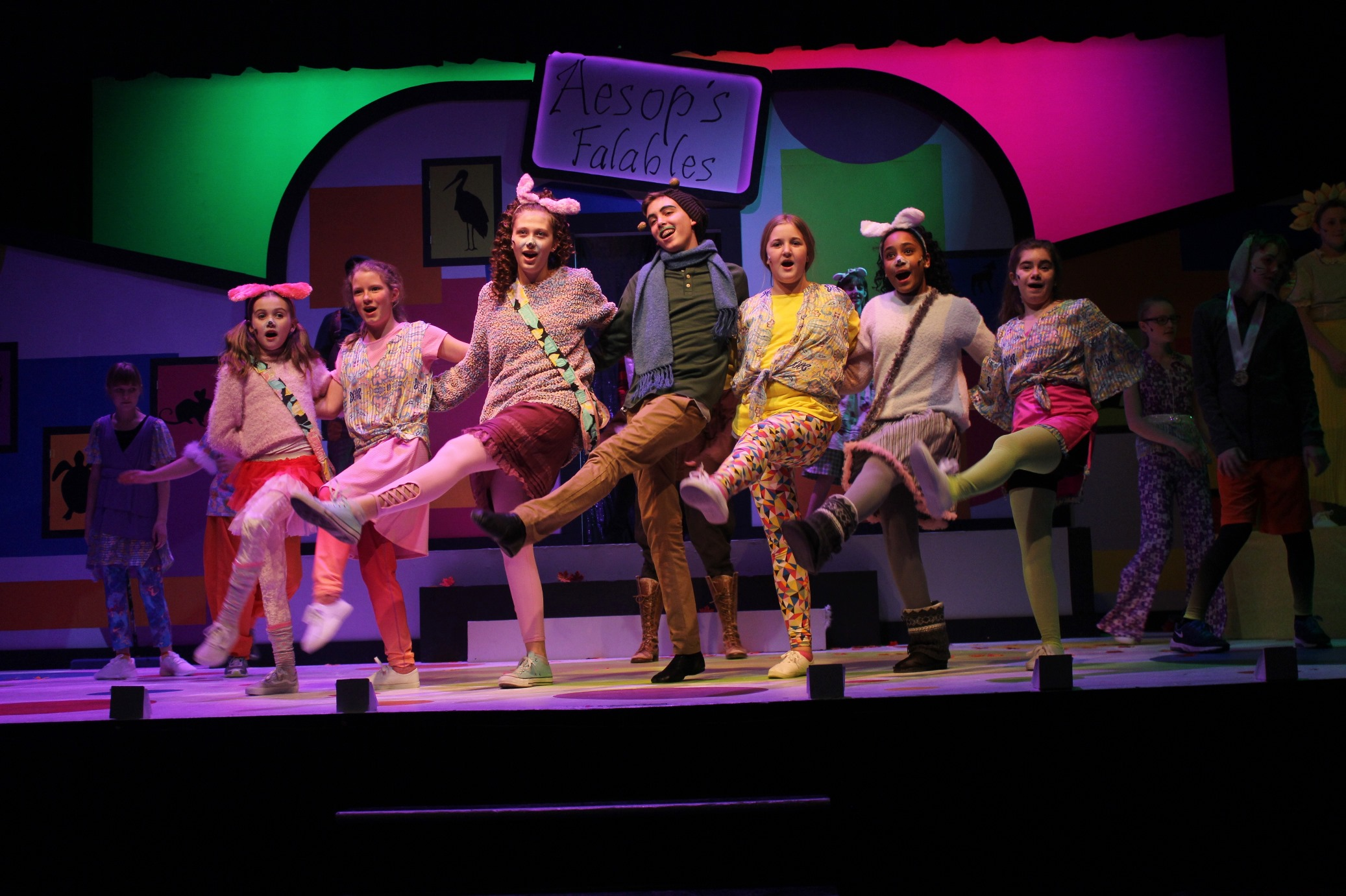 The cast does a kickline in DJT's  Aesop's Falables