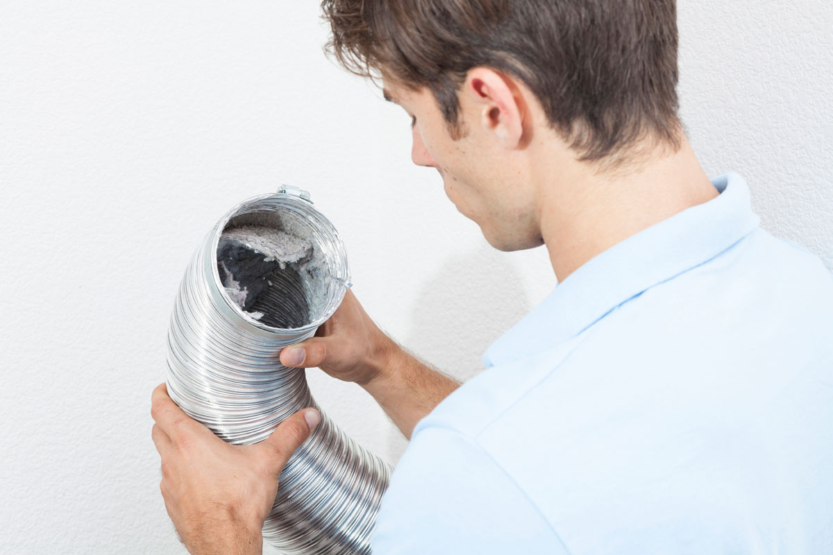 Tech-looking-into-vent-hose.jpg