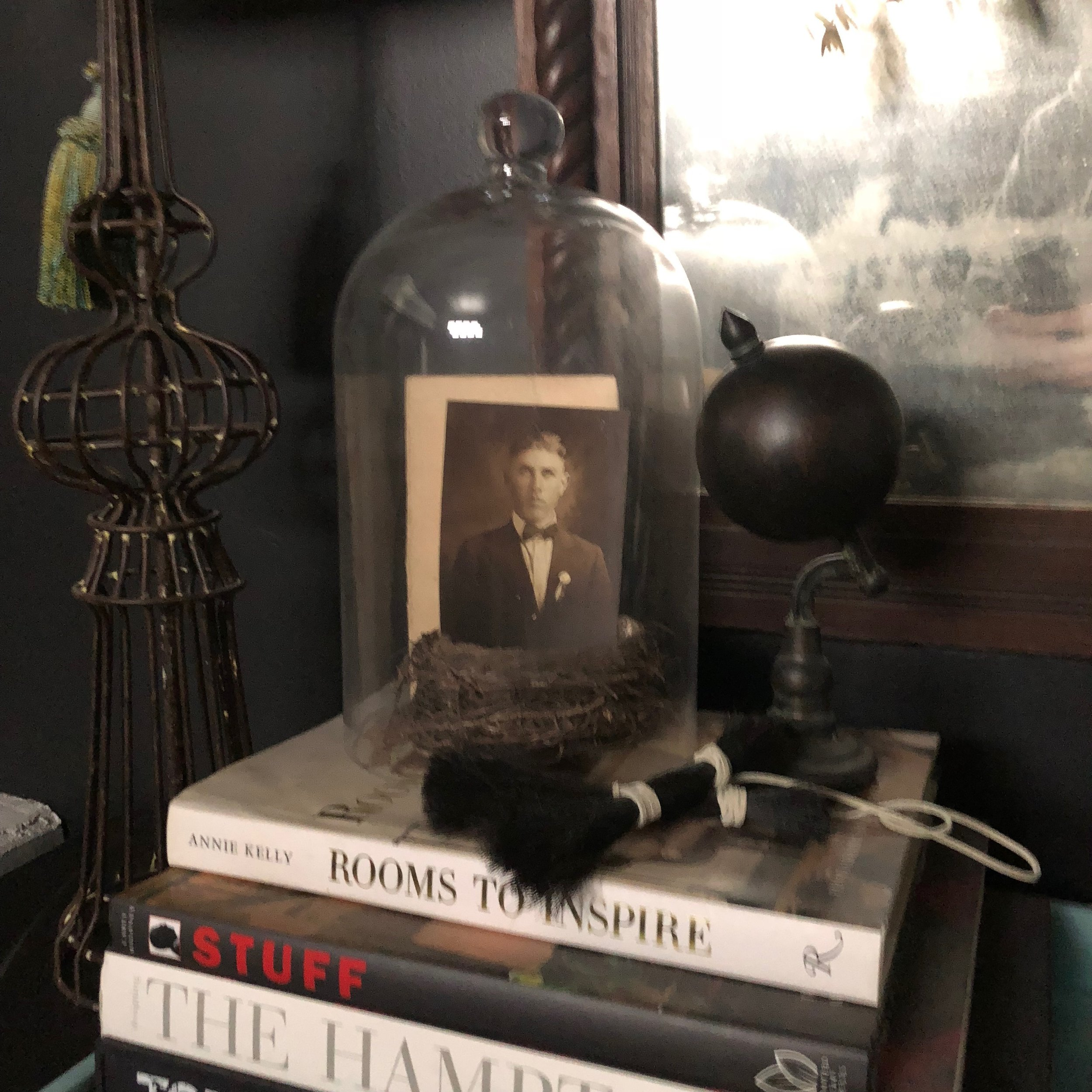 Cloche call... - A photo of Collin's grandfather, Sylvan is nested inside a cloche in the entry.