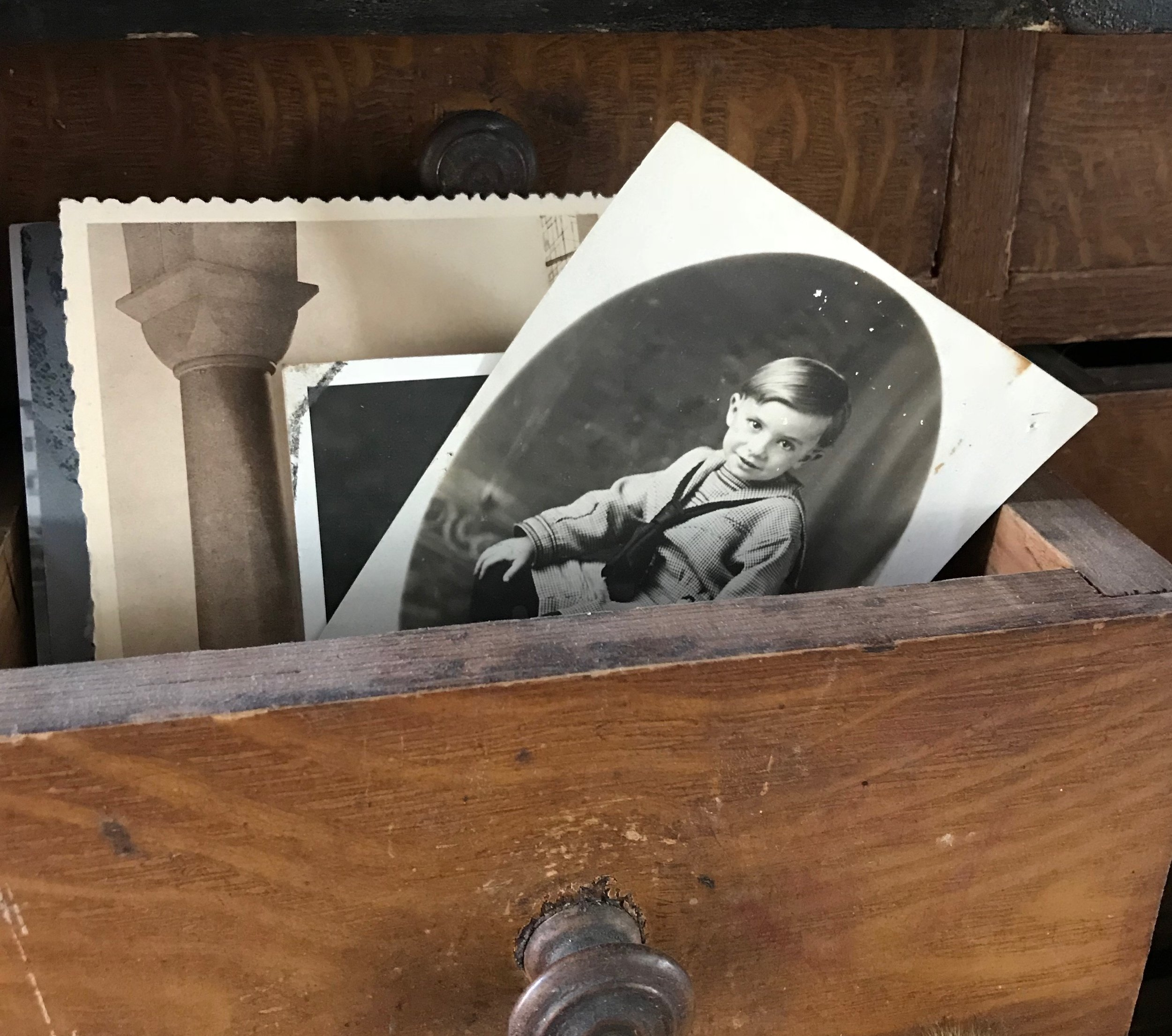 Snapshots... - A photo of Trent's grandfather, Seab peeks out of a drawer filled with family photos in the Trophy Room.