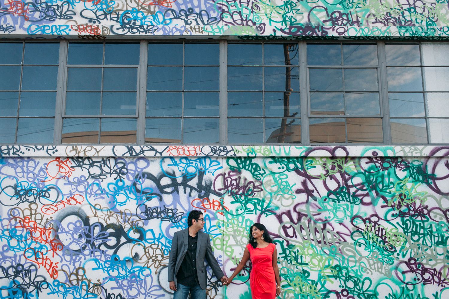 Karen and Uday in front of graffiti walls in the Design District.