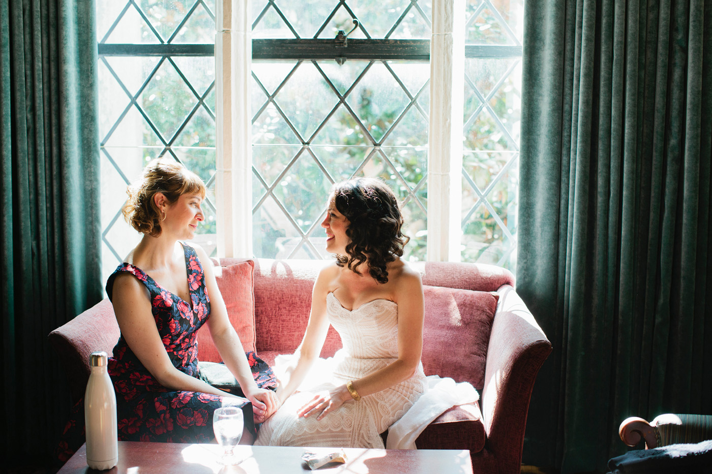 Cara and her sister-in-law have a quiet moment just before the ceremony during her Berkeley Faculty Club wedding.