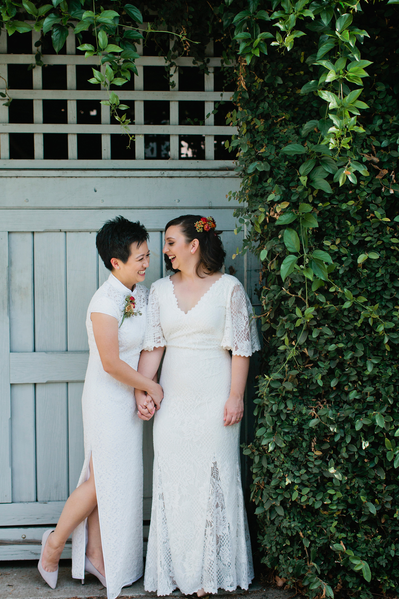We scouted a beautiful vine wall for Kylie and Sophia's portraits but found it had been cut down on their wedding day. Luckily, we moved on to this garage door as an alternative.