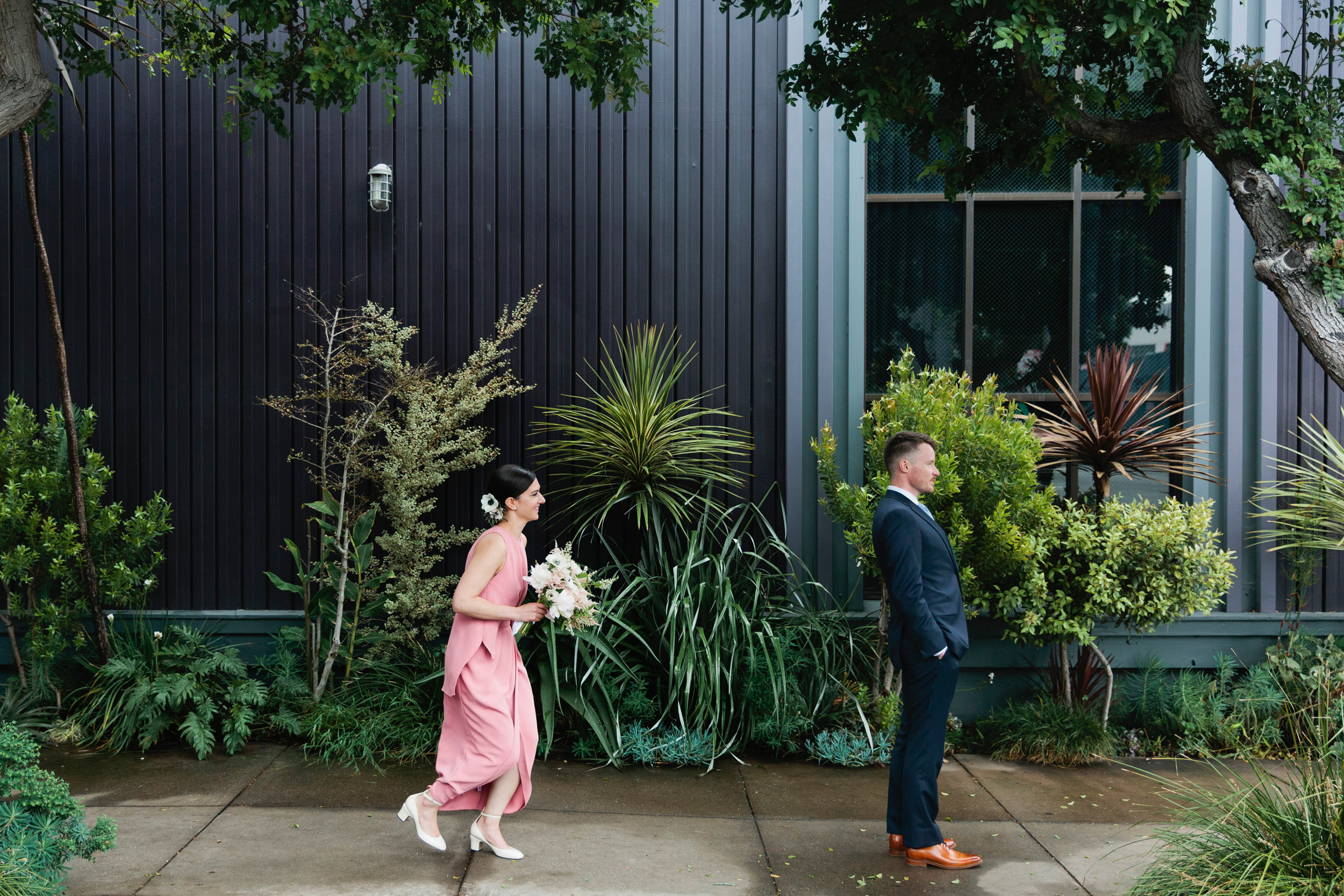 Julia and Dan met up in the Design District for their first look and couple's portraits. This meant staggering their arrival times (Dan showed up first) and then planning how Julia entered (both by car and on foot) so that Dan wouldn't accidentally see her.