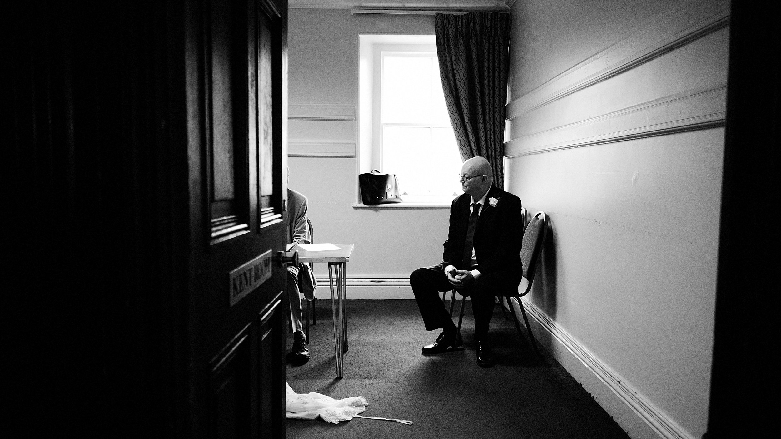 Dad waiting during the interview with registrars - A Kendal wedding, Lake District