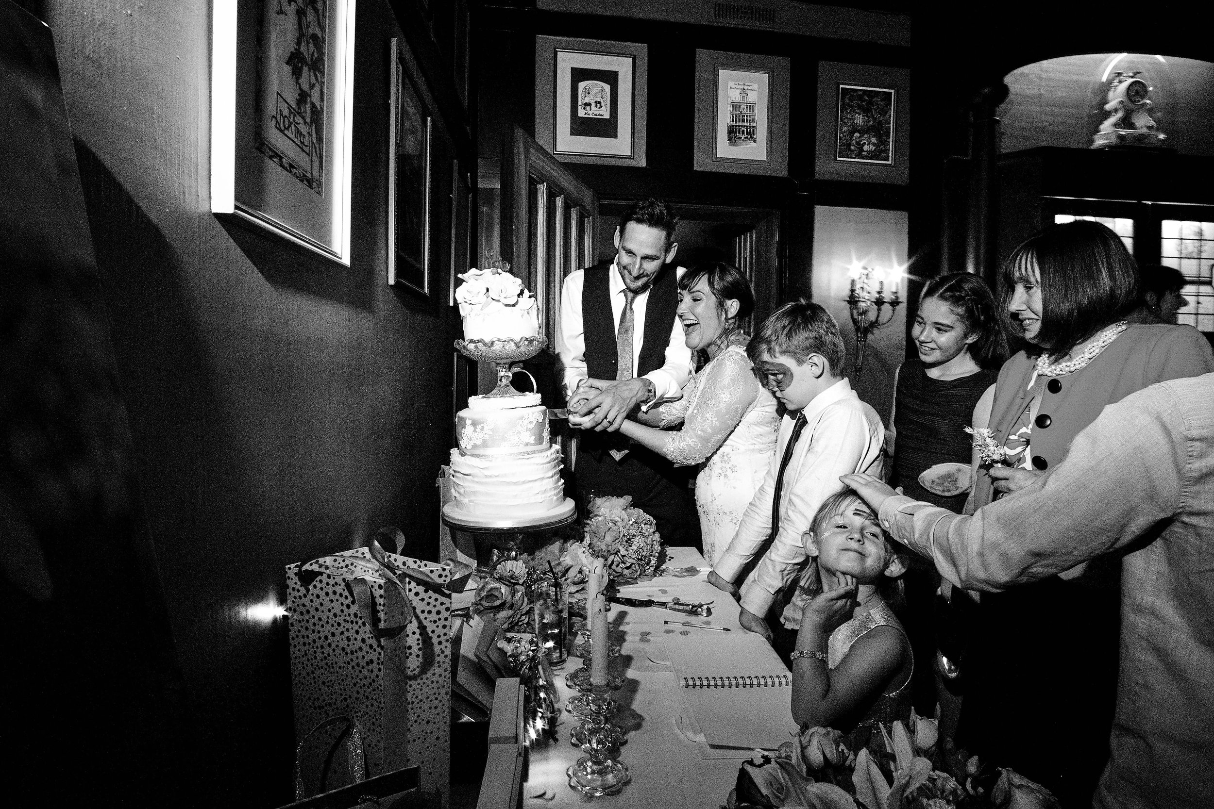 Cutting the wedding cake at the Belle Époque in Cheshire.  Photographed documentary style.