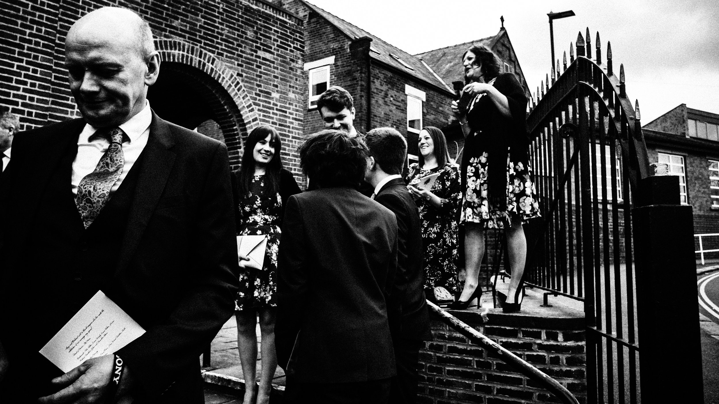 Wedding guests trying to get a better view of the bride and groom