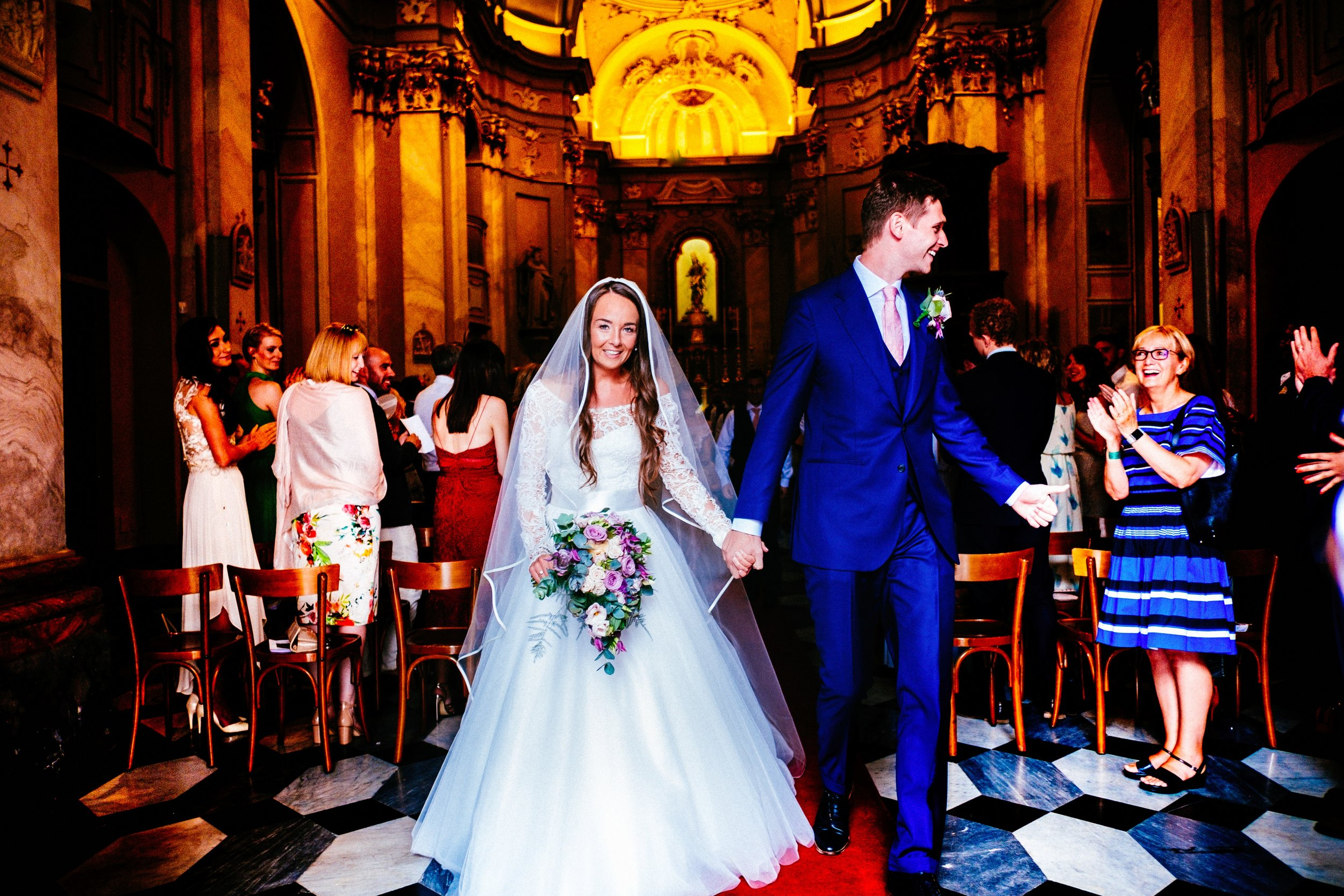 bride and groom just married in lake como italy by relaxed wedding photographer bomknights