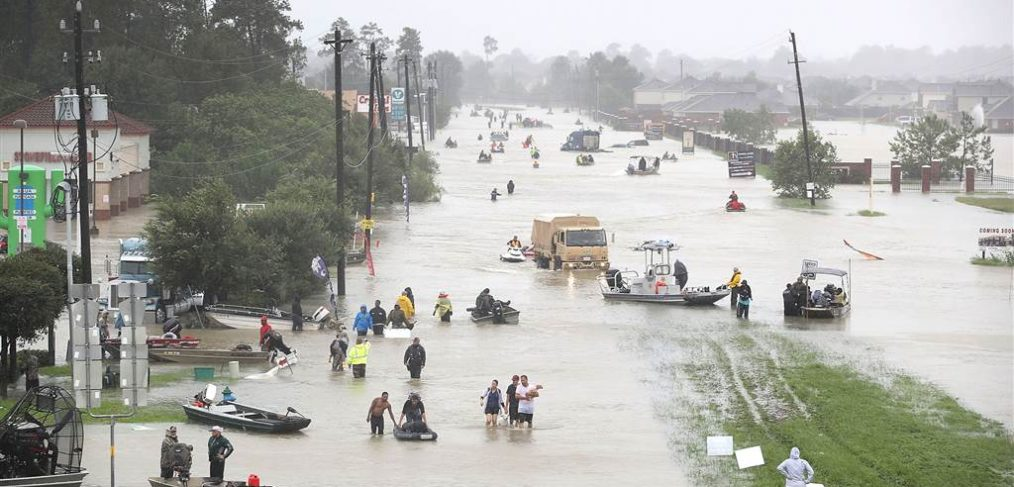 Residents wade through flood waters from Tropical Storm Harvey in Houston, Texas.