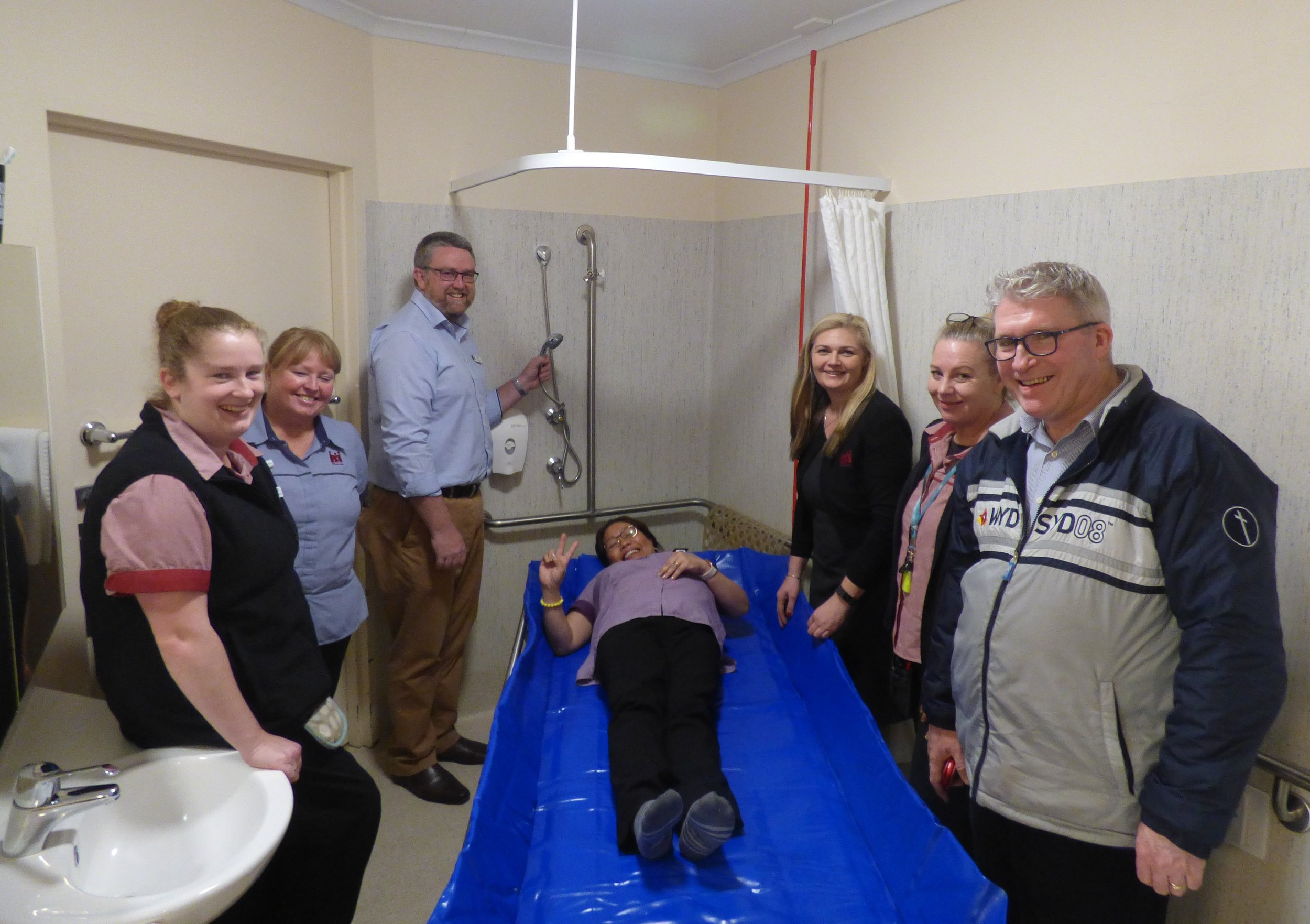 MPNH Staff trialling the new shower trolley.jpg