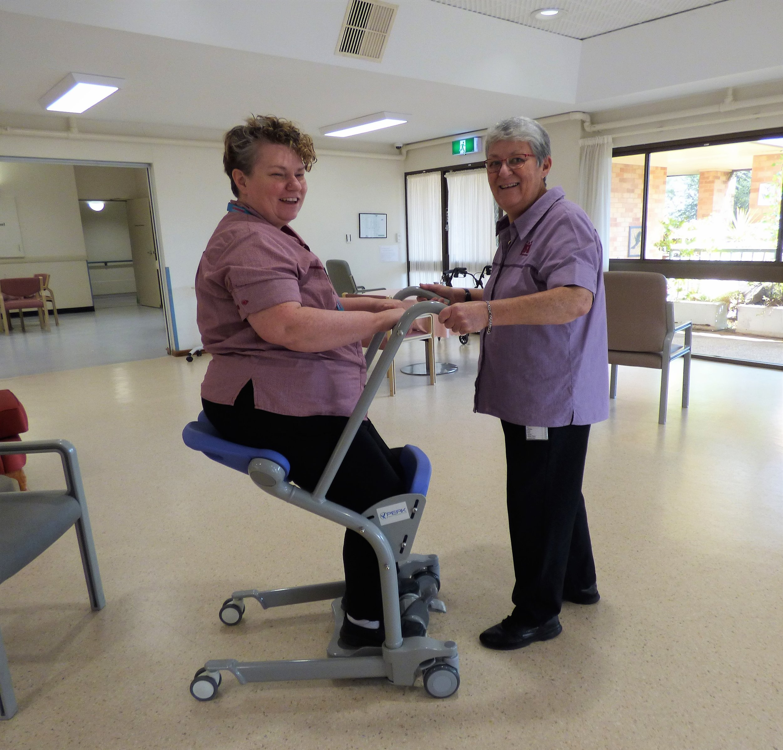 Tina and Cheryl test the transfer assist trolley at LHOC.jpg