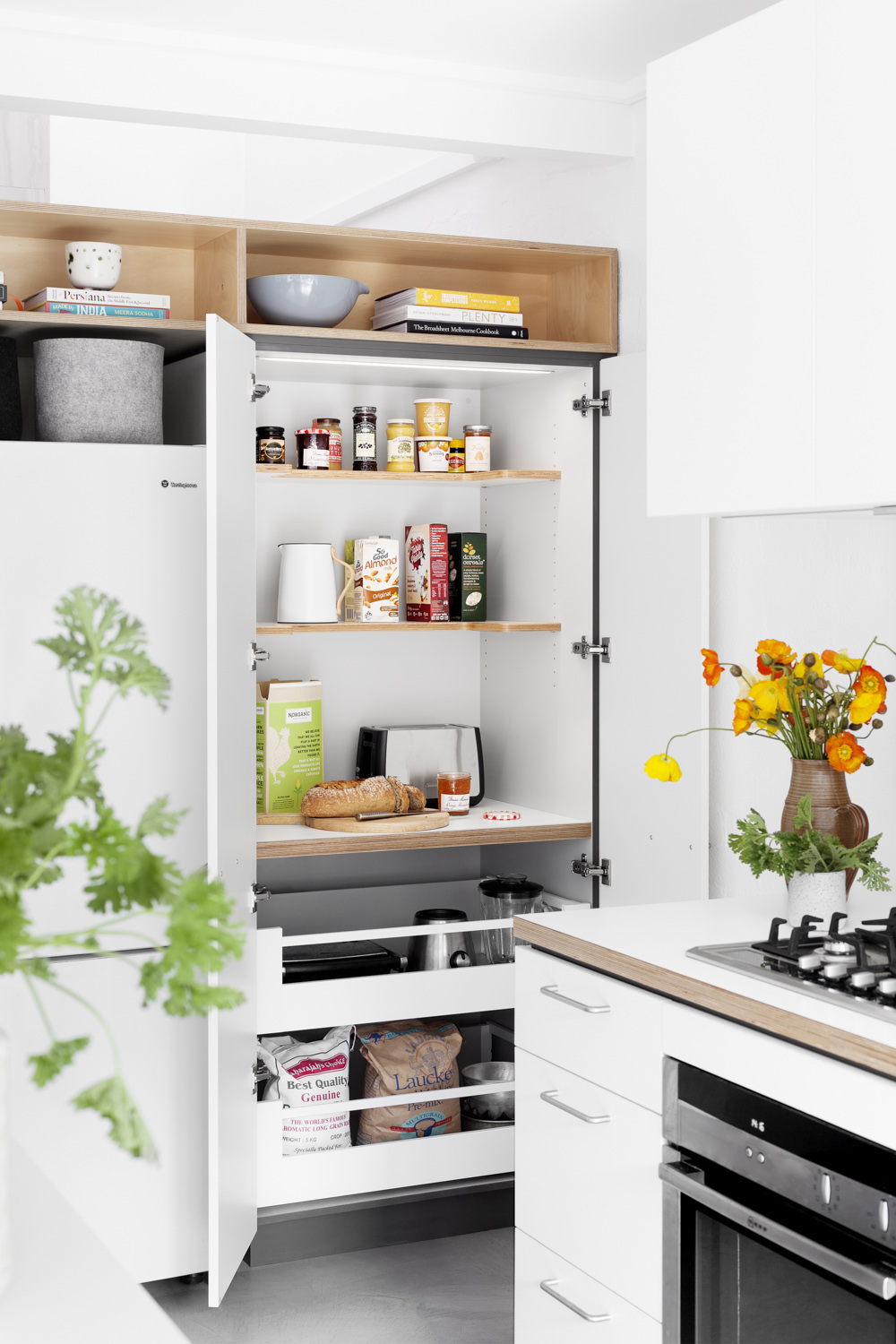 The Cantilever Appliance Cabinet is a work space and storage cabinet in one designed to make daily food prep tidy without the fuss.