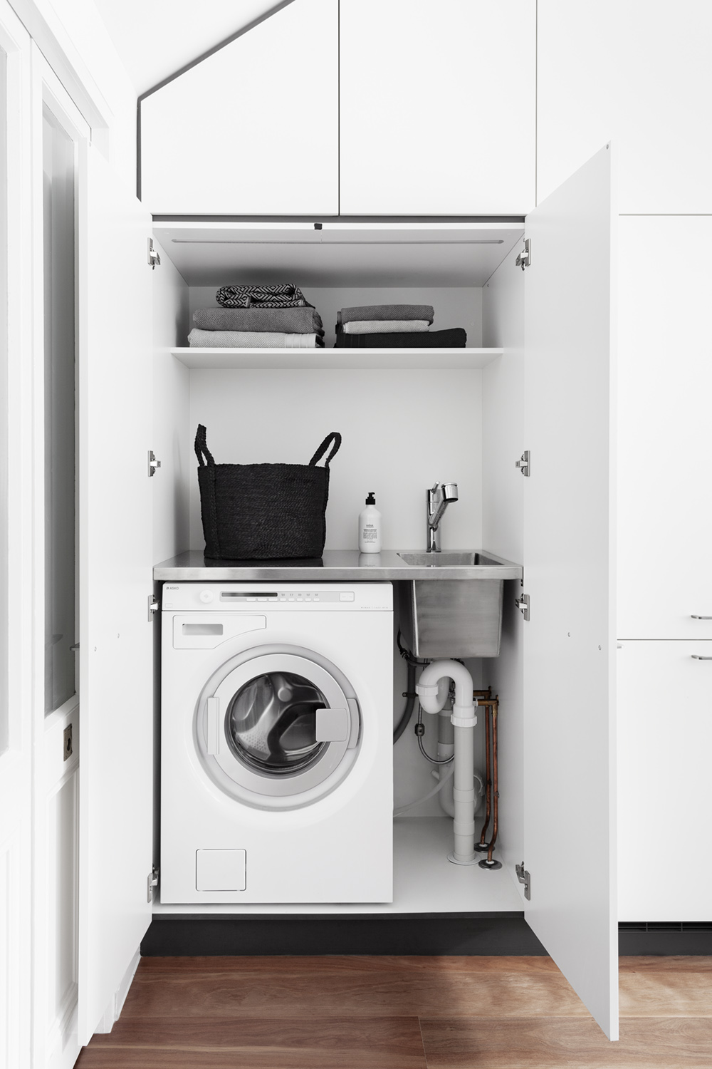 Design Tip:    For euro laundries and compact spaces, consider a stainless steel bench top with integrated sink. Not only will it cope better with frequent exposure to laundry agents not recommended for stone but the whole surface can be utilised as a wet area.