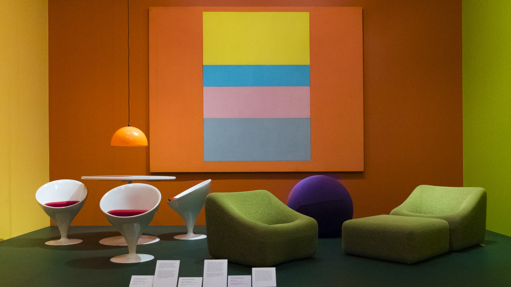 The vivid 'Plastic & Pop' display features Featherson's exploration of advanced plastic technology in the 1960s and 70s. L - R: Stem Dining Setting, Obo Chair and Numero IV lounge.