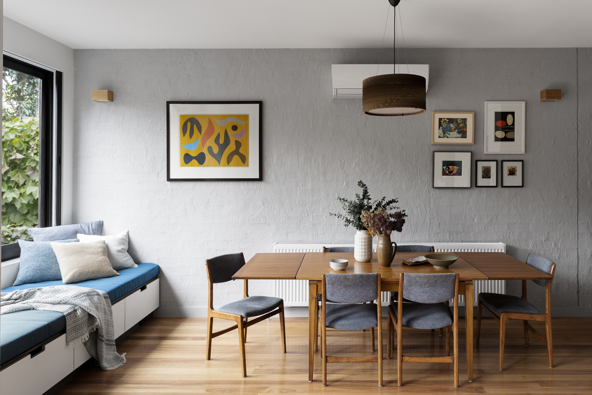 The John Coburn print (left) is a family favourite and influenced the colour scheme for the house.
