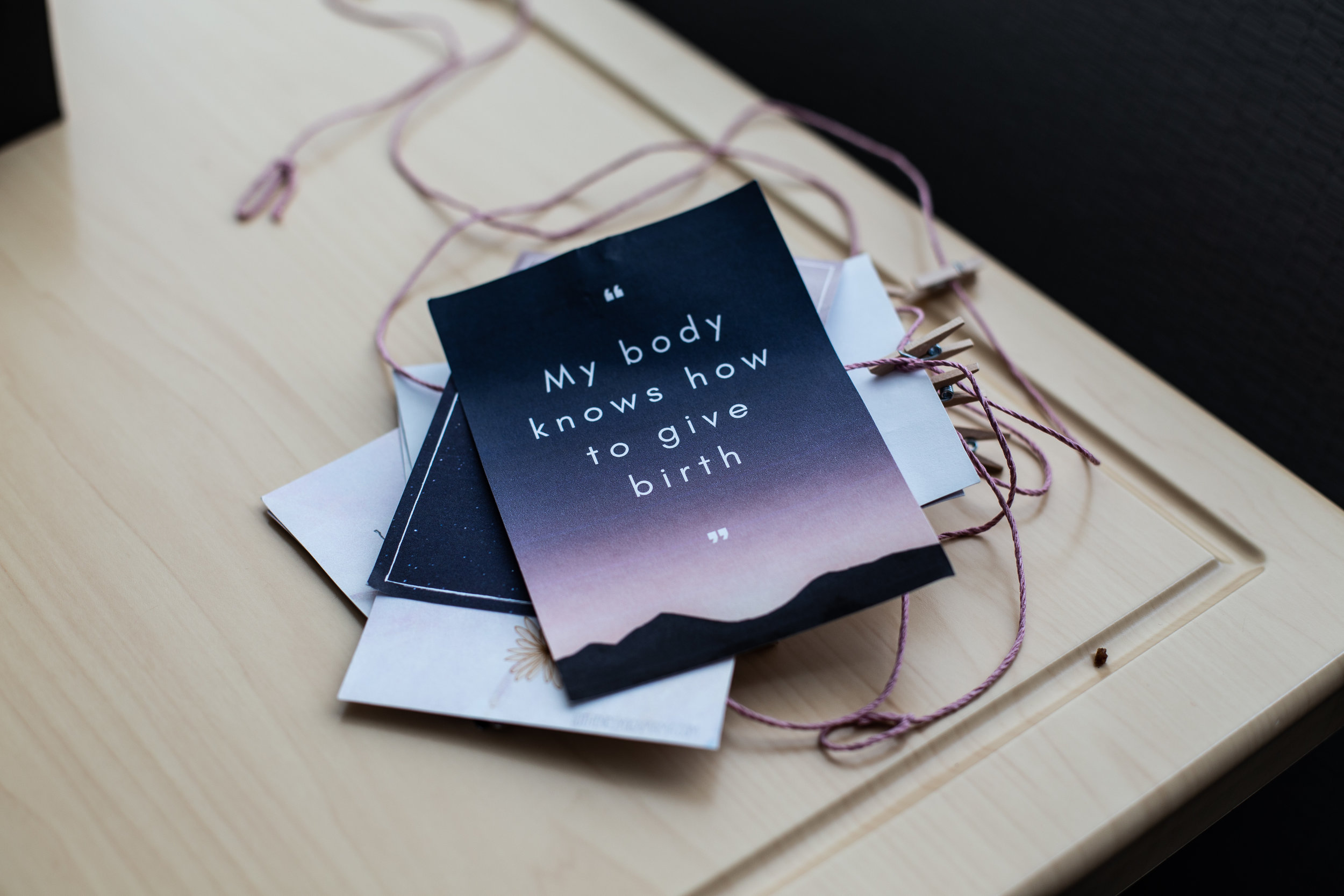 Birth affirmation cards lying on a table.