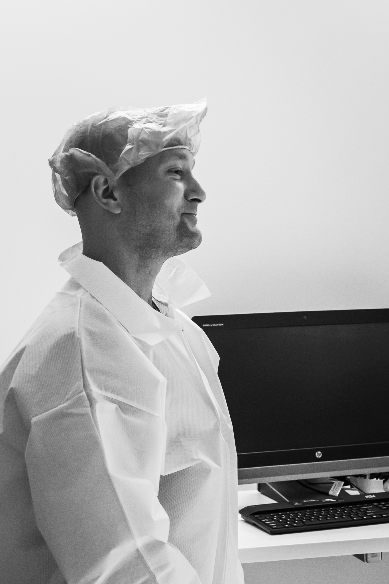 Black and white photo of a man with surgery scrubs.