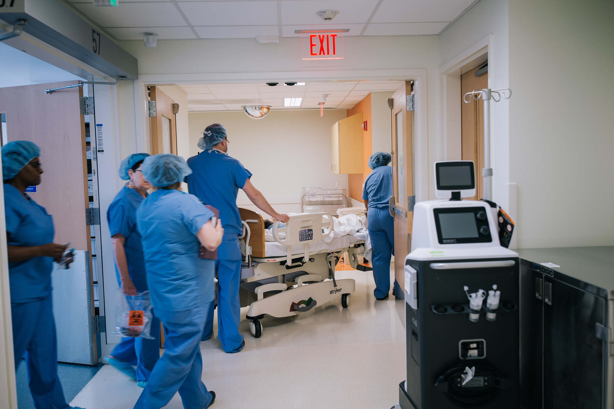 Wheeling a mom out of the operating room after a cesarean section.
