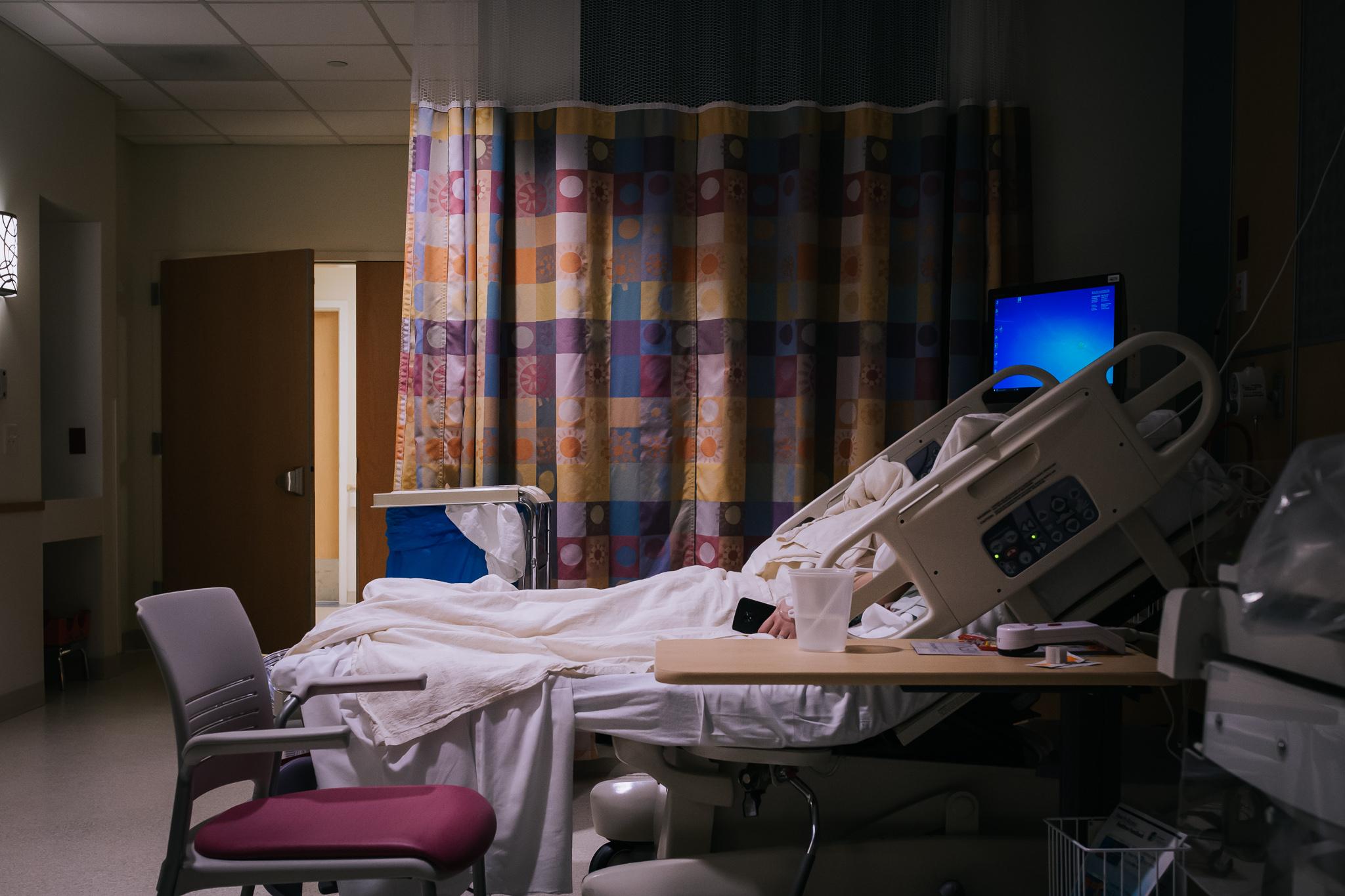 A mom sleeps after surgery.