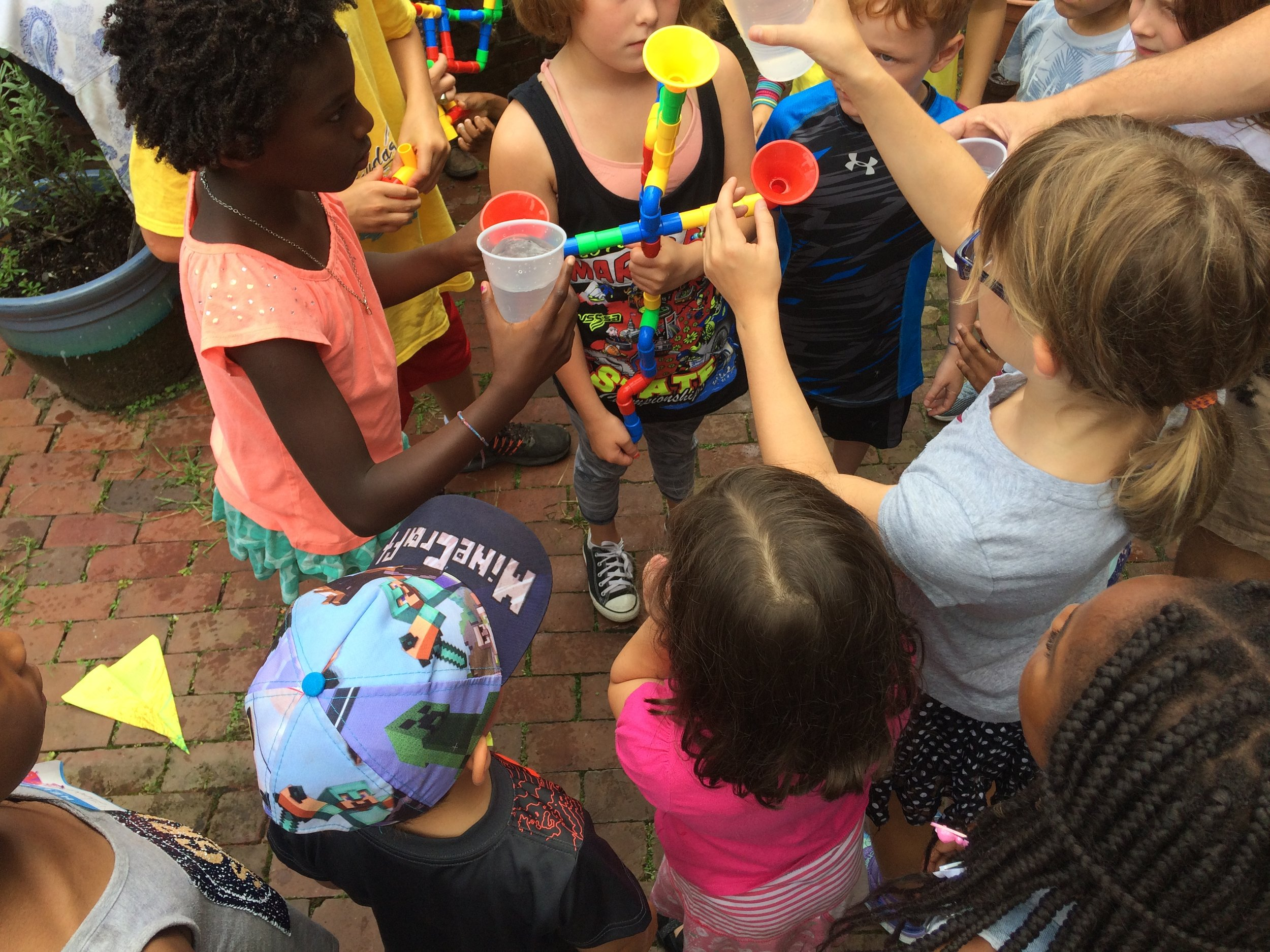 Campers built a plumbing system experiment.JPG