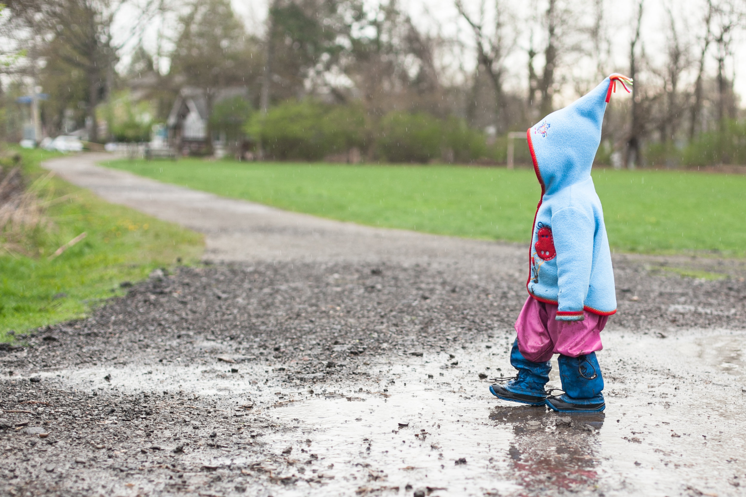 The Family Photographer Jenny Stein My Mayu Boots child walking in rain