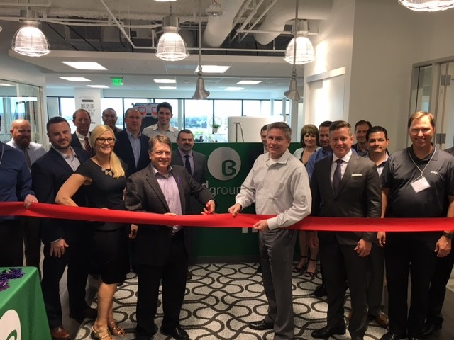 Hart with Burwood Group Founder Mark Theoharous and extended team at the grand opening of Burwood's San Diego Network Operations Center (April 2017).
