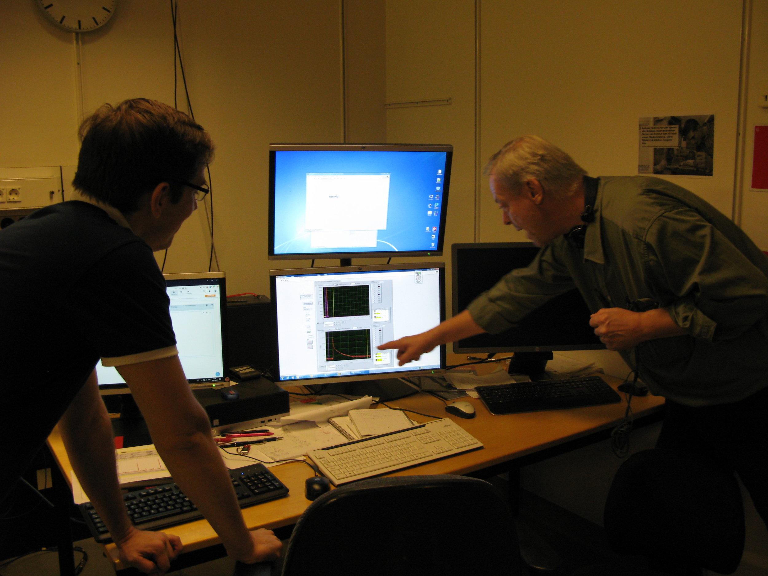 Klavs and Vitali in the DESIREE control room.