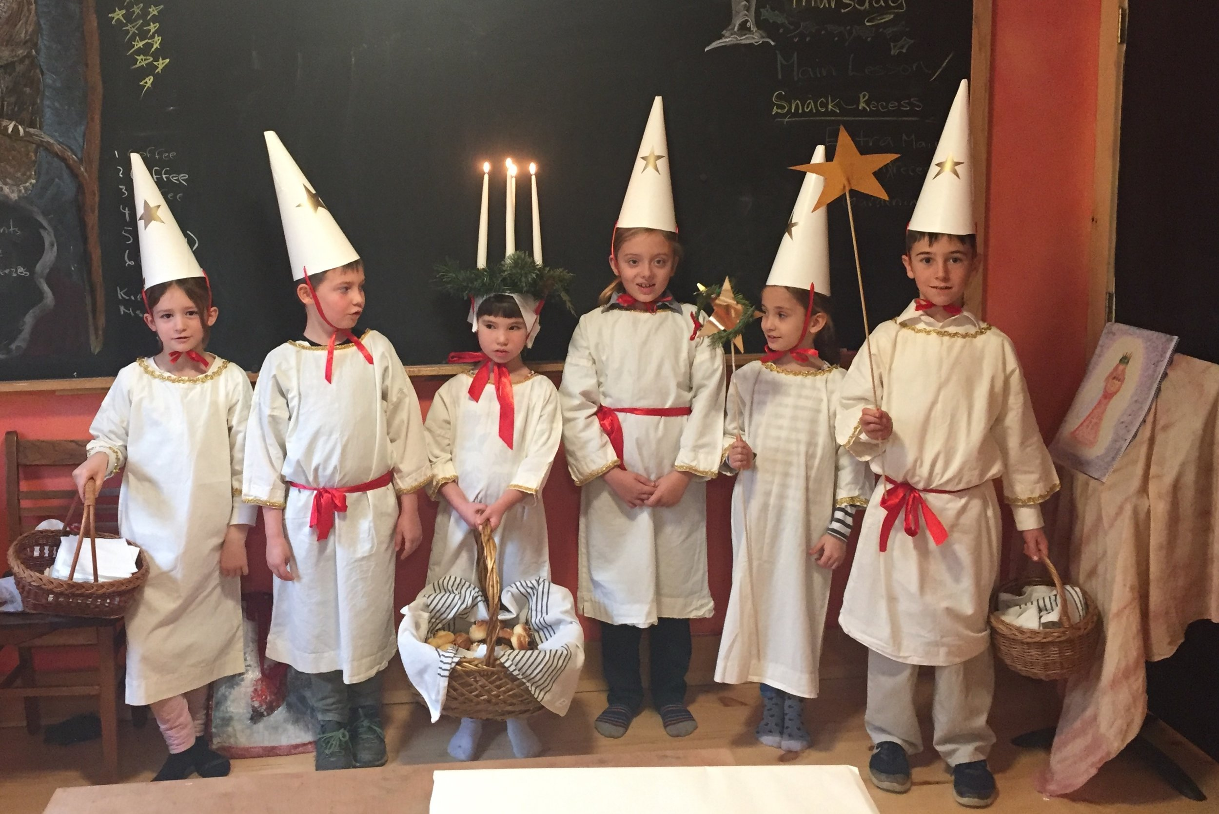 Santa Lucia is a Swedish traditional festival. Children bake special buns and share them with the school as a gesture of caring for others.