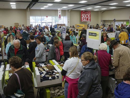 Shoppers peruse boxes of socks during the annual Fox River sock sale on Friday, Oct. 6, 2017, in Osage. (Photo: Bryon Houlgrave/The Register)